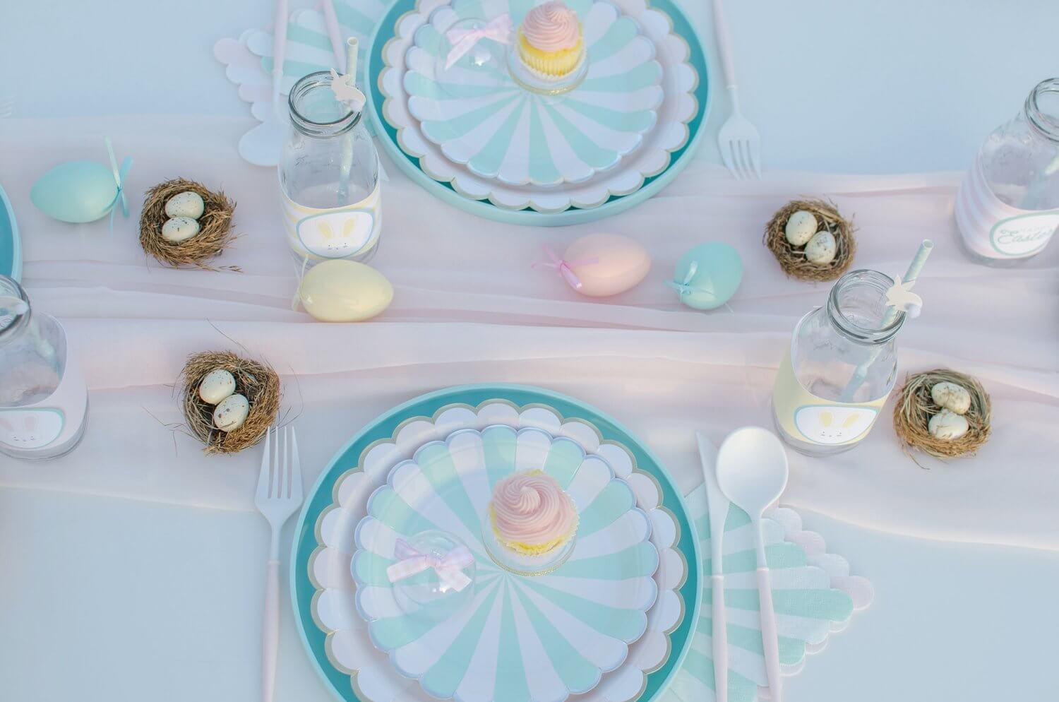 Pretty party paper supplies for an Easter garden party in pink and mint colors. Cute little nests with speckled Easter eggs are the perfect favor. Styling by Mint Event Design www.minteventdesign.com #easterparty #gardenparty #partysupplies #tablescape #eastertable