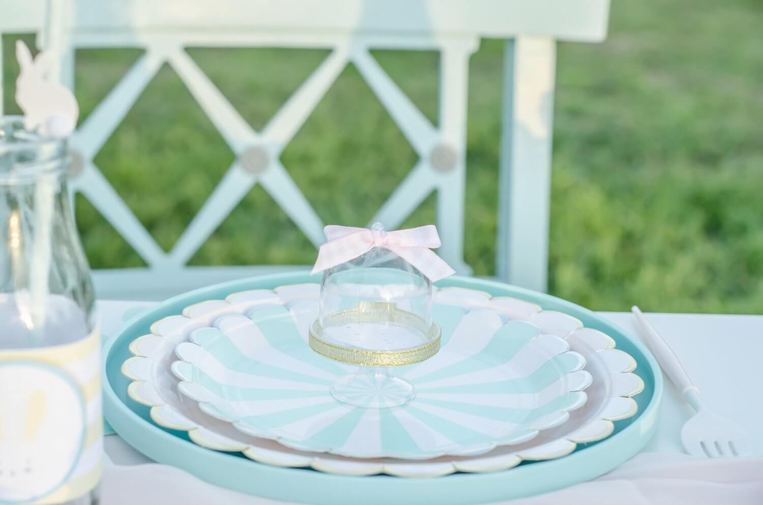 Pretty party paper supplies for an Easter garden party include the cutest mini cupcake stand. Styling by Mint Event Design www.minteventdesign.com #easterparty #gardenparty #partysupplies #tablescape #eastertable