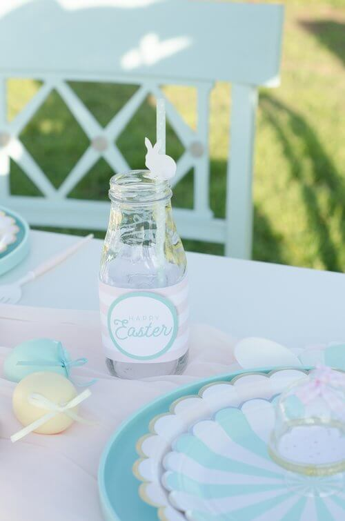 Cute bottle wrappers for the milk bottles add the perfect detail to this Easter Garden Party for Kids. The wrappers are a free download from Mint Event Design www.minteventdesign.com #easterparty #gardenparty #partysupplies #tablescape #eastertable #freeprintable