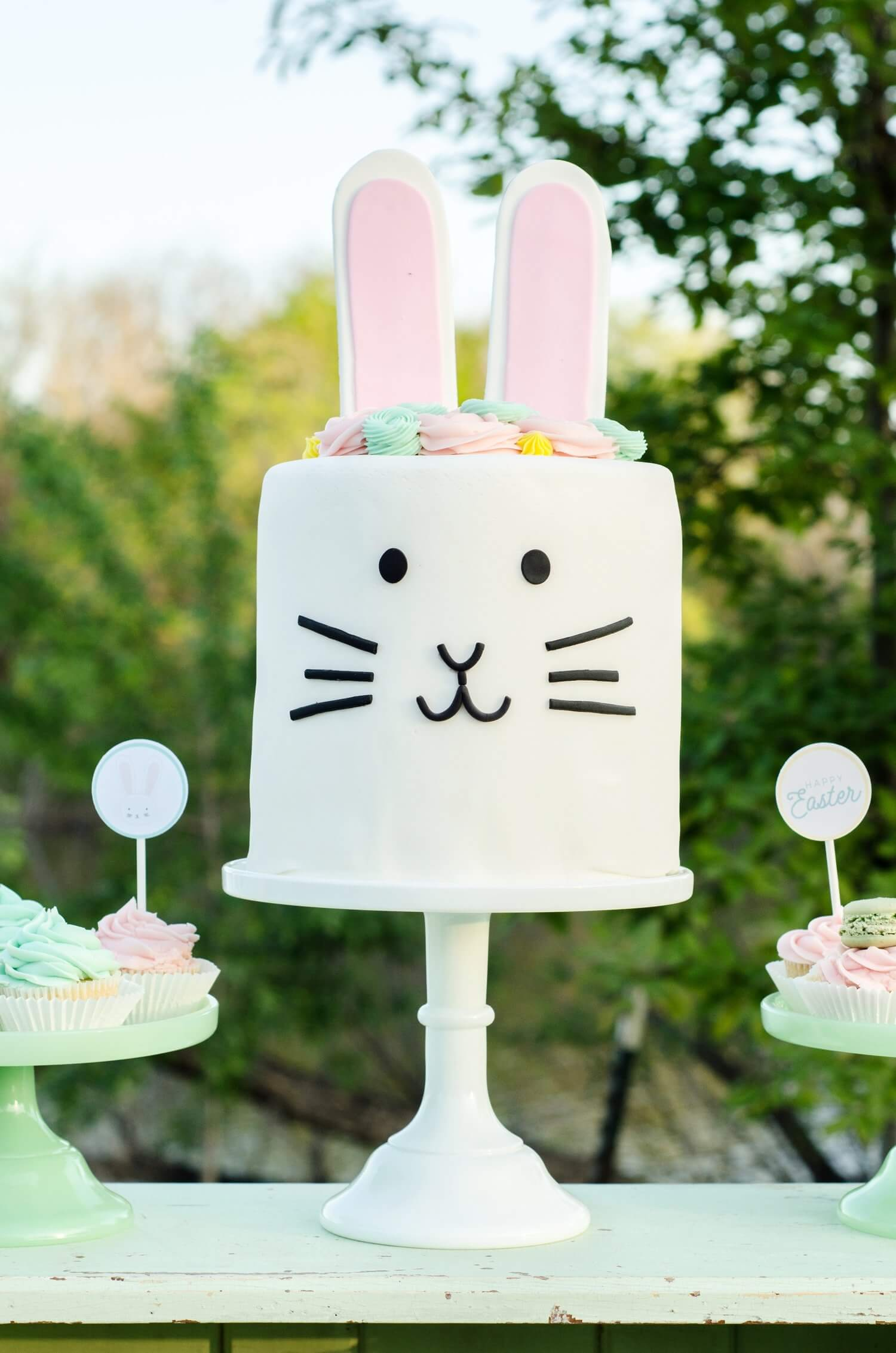 This is the cutest Easter bunny cake and there's even free party printables that match this mint green and pink Easter Party. See more Easter Garden Party Ideas for Kids on Mint Event Design www.minteventdesign.com #easterparty #gardenparty #partysupplies #eastercake #partycake