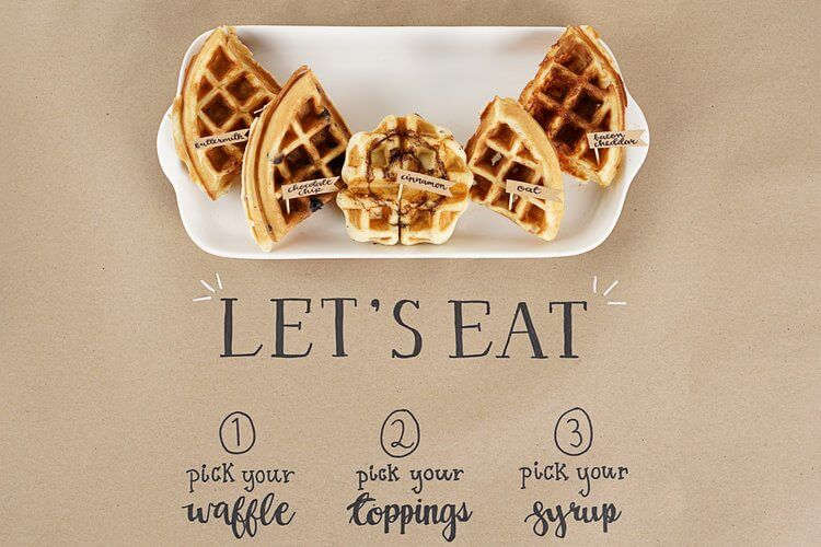Directions for the Waffle Bar are handwritten directly on the kraft brown paper that is used a tablecloth on the serving table. Leave the tented cards behind and simply make use of your tablecloths. Find the complete how to guide for setting up a waffle bar on Mint Event Design www.minteventdesign.com #wafflebar #brunch #breakfast #mothersday #brunchideas #partyideas