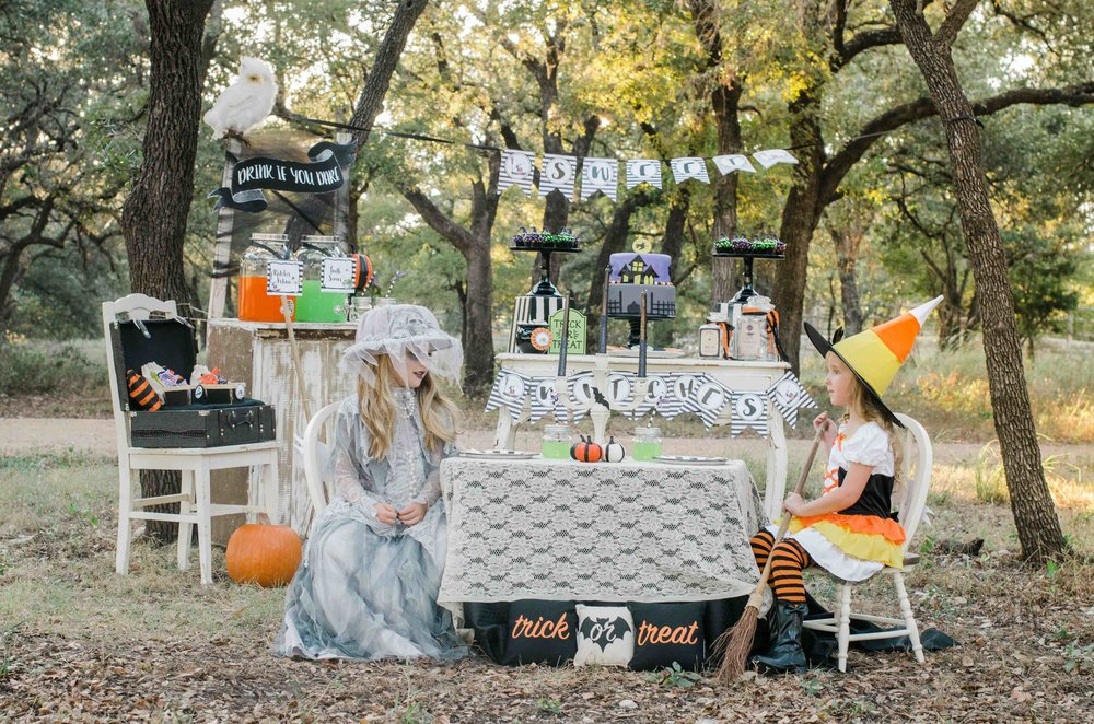 It's a Little Witches' Soiree Halloween Party with so many amazing Halloween Party Ideas for the dessert table and even the cutest Halloween Costumes for Girls with fun Halloween party printables and banners. Click to see all the Halloween Party Ideas that you can re-create for your very own Halloween Kids Party. Styled by party stylist Mint Event Design. #halloween #partyideas #partyinspiration #partydecor #partyprintables #desserttable #halloweenprintables #halloweendecorations