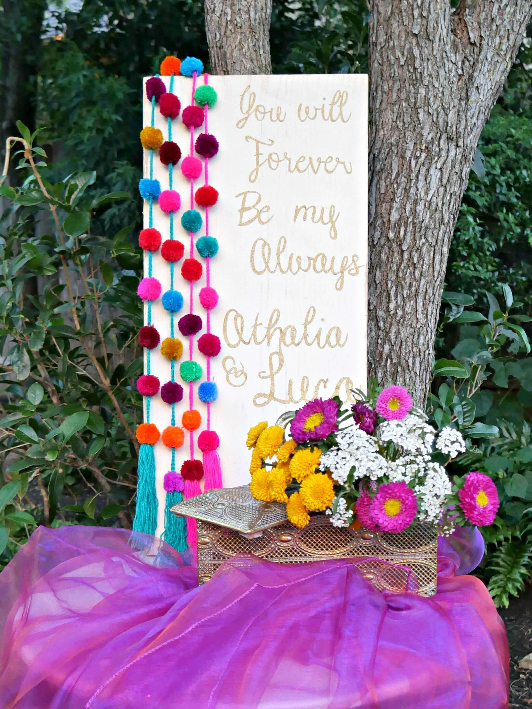 Having a welcome table to greet your guests is a great idea because it really sets the tone for the party and gets the guests excited to see what is coming next. This welcome sign was created for an engagement party and the couple can keep it for their home decor. Styled by Mint Event Design in Austin Texas www.minteventdesign.com #engagementideas #welcometable #welcomesign #bohochic