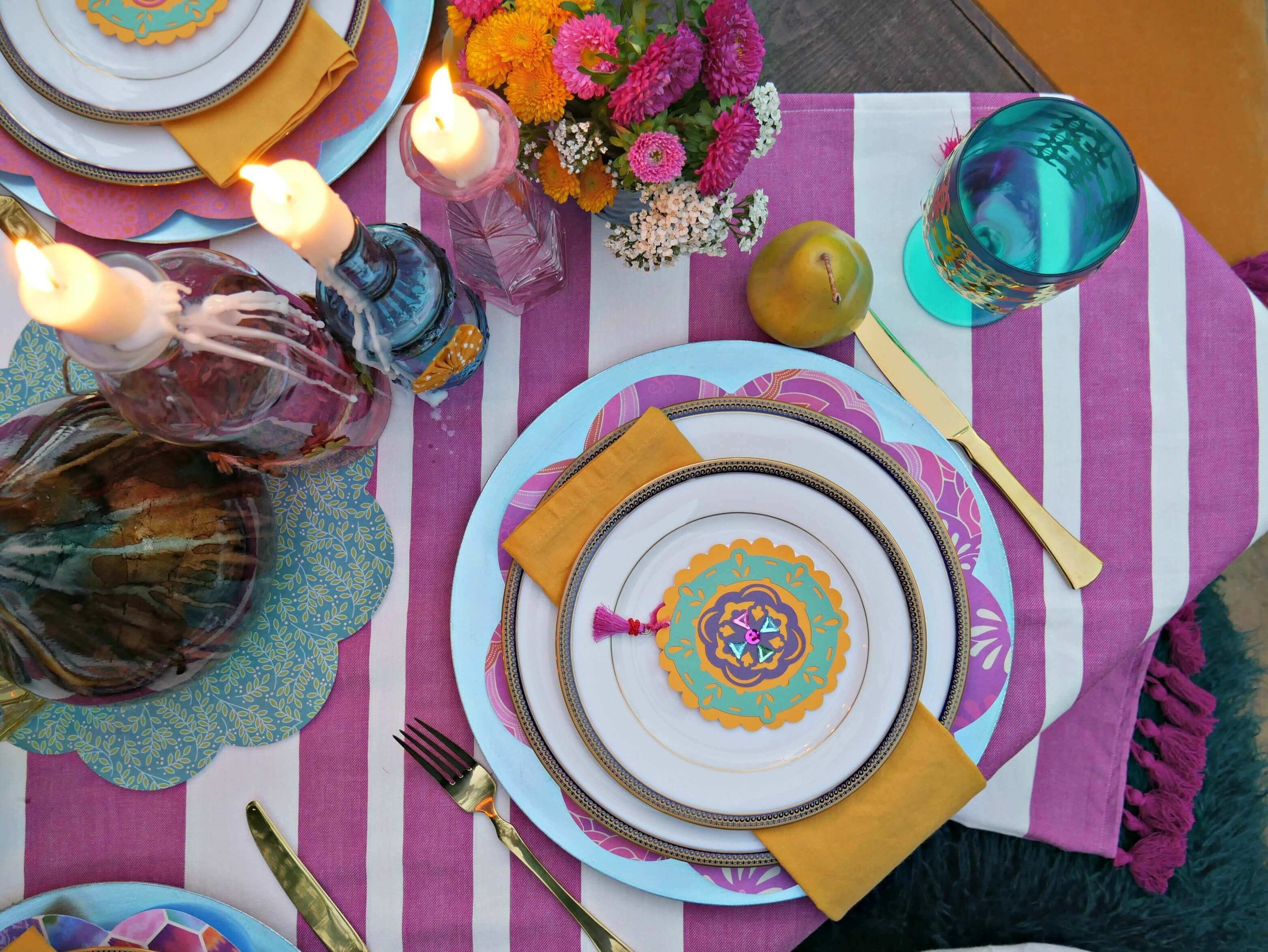 Boho and beautiful! This engagement party is inspired by jewel tones and pretty patterns. Styled by Mint Event Design www.minteventdesign.com #tablesetting #tablescapes #bohochic #engagementparty
