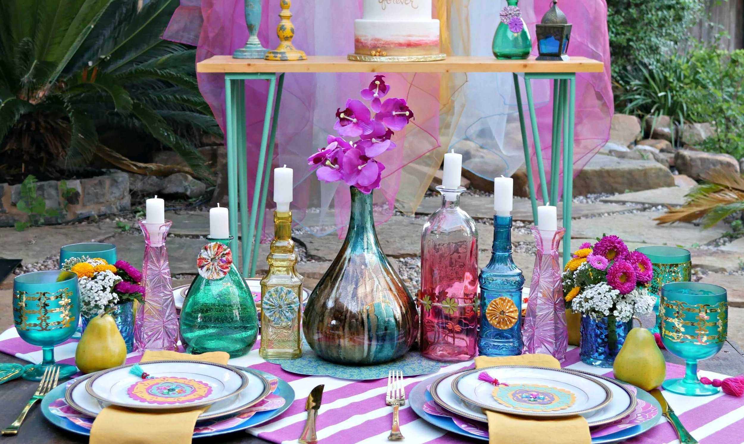 This jewel toned party is bold, beautiful and full of color. Dress up your next celebration with a boho chic vibe and include lots of colorful vases and pretty patterns. Created by Mint Event Design www.minteventdesign.com #tablesetting #tablescapes #bohochic #engagementparty #cricutdiy