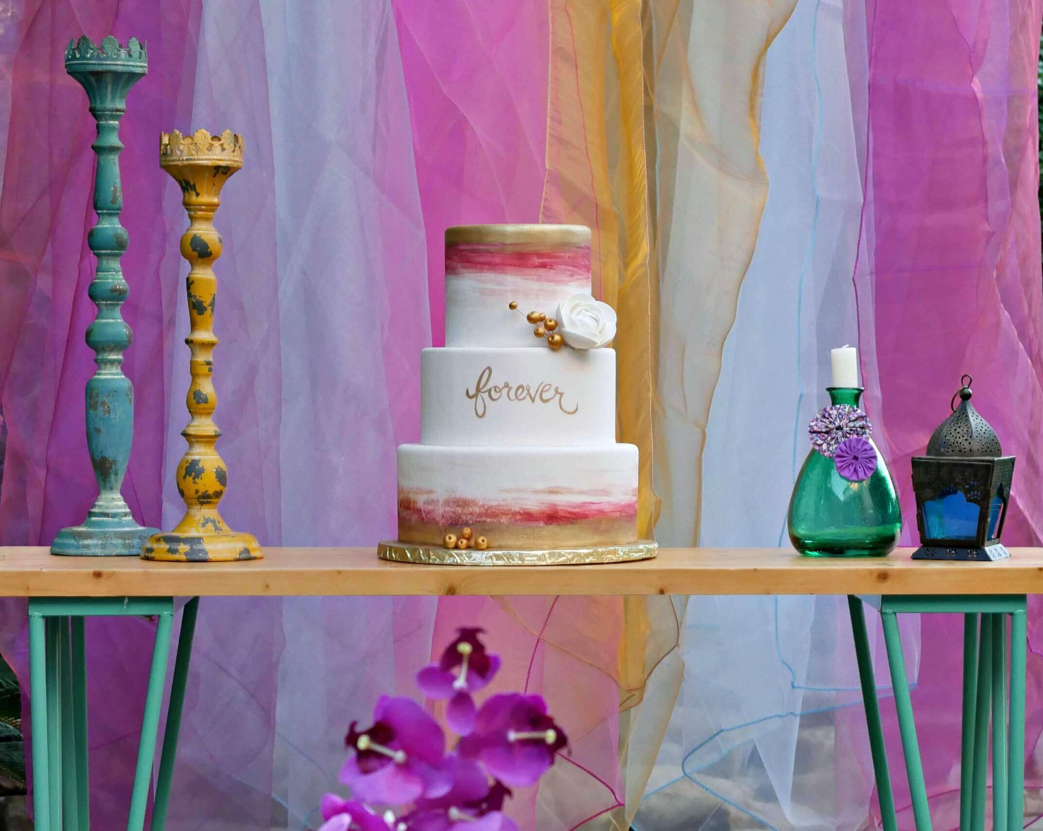 Love this wedding cake for a Gypsy party theme Engagement Party with a bohemian style. Styling by Mint Event Design www.minteventdesign.com #caketable #weddingcake #weddingcakes #bohochic #watercolorcake