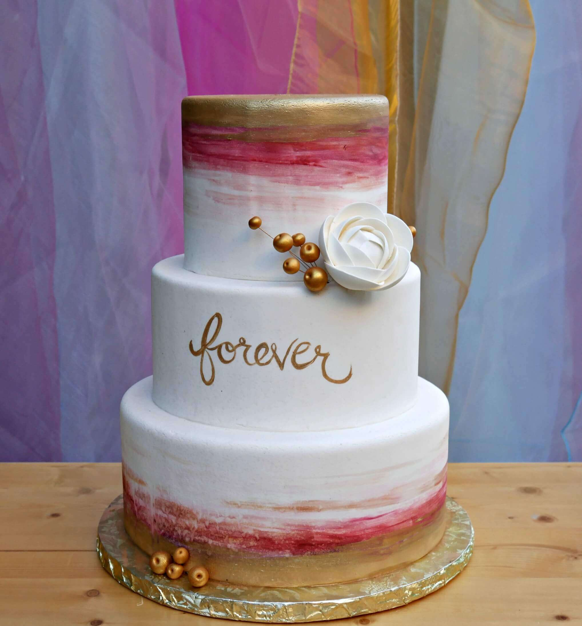 Love this Engagement Party Watercolor Cake with gold foil and sugar flower. Created by Michelle's Patisserie and styled by Mint Event Design in Austin Texas www.minteventdesign.com #caketable #weddingcake #weddingcakes #bohochic #watercolorcake
