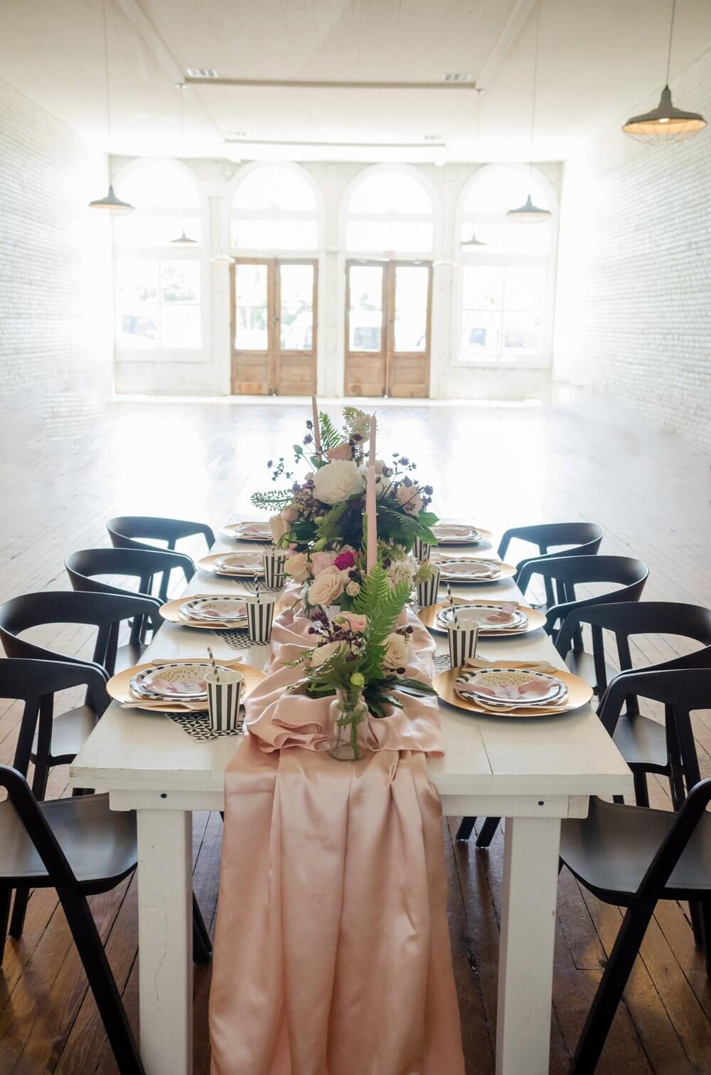Beautiful tablescape with pink and black accents, perfect for a bridal shower