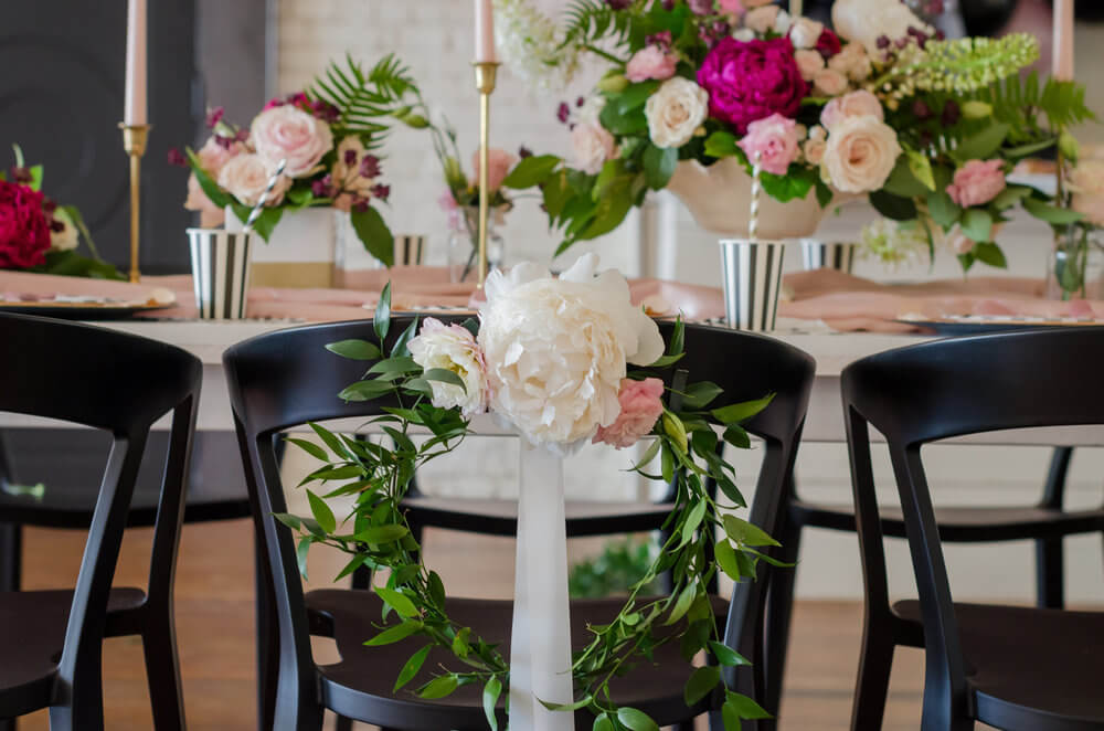 Beautiful chair accent with fresh flowers, perfect for the bride
