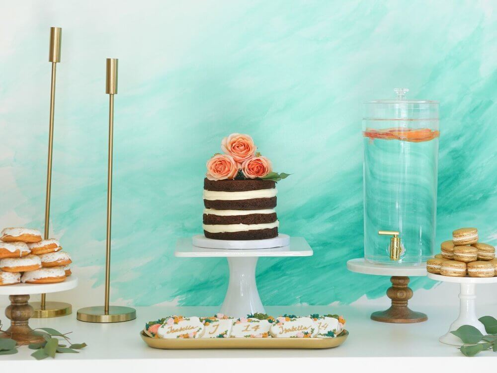 Lovely watercolor backdrop for a dessert table