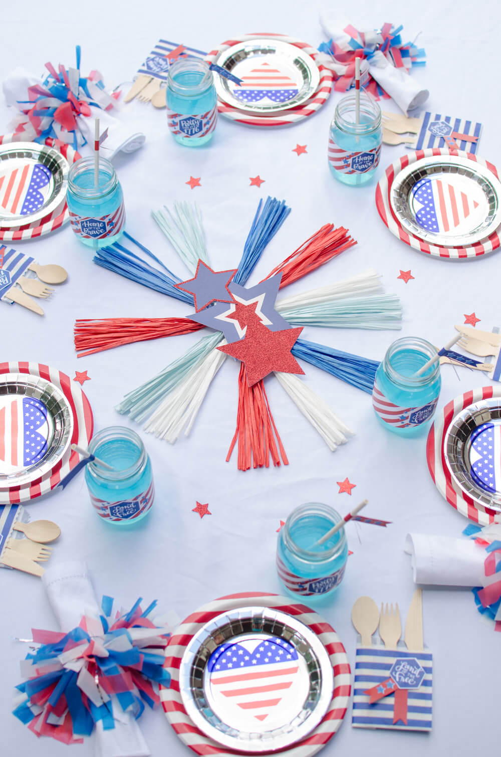 Beautiful and festive table decor filled with red, white, and blue, stripes, flags, stars, and fireworks!