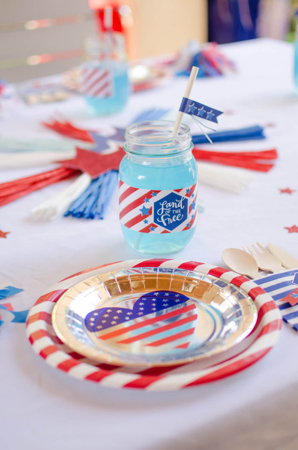 Mason jar cups with a paper label, paper straw, and blue liquid, is perfect for 4th of July.