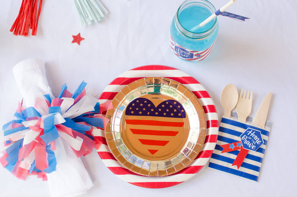 Fireworks napkin ring, gold plate with American flag heart motif, and lots of red, white, and blue.