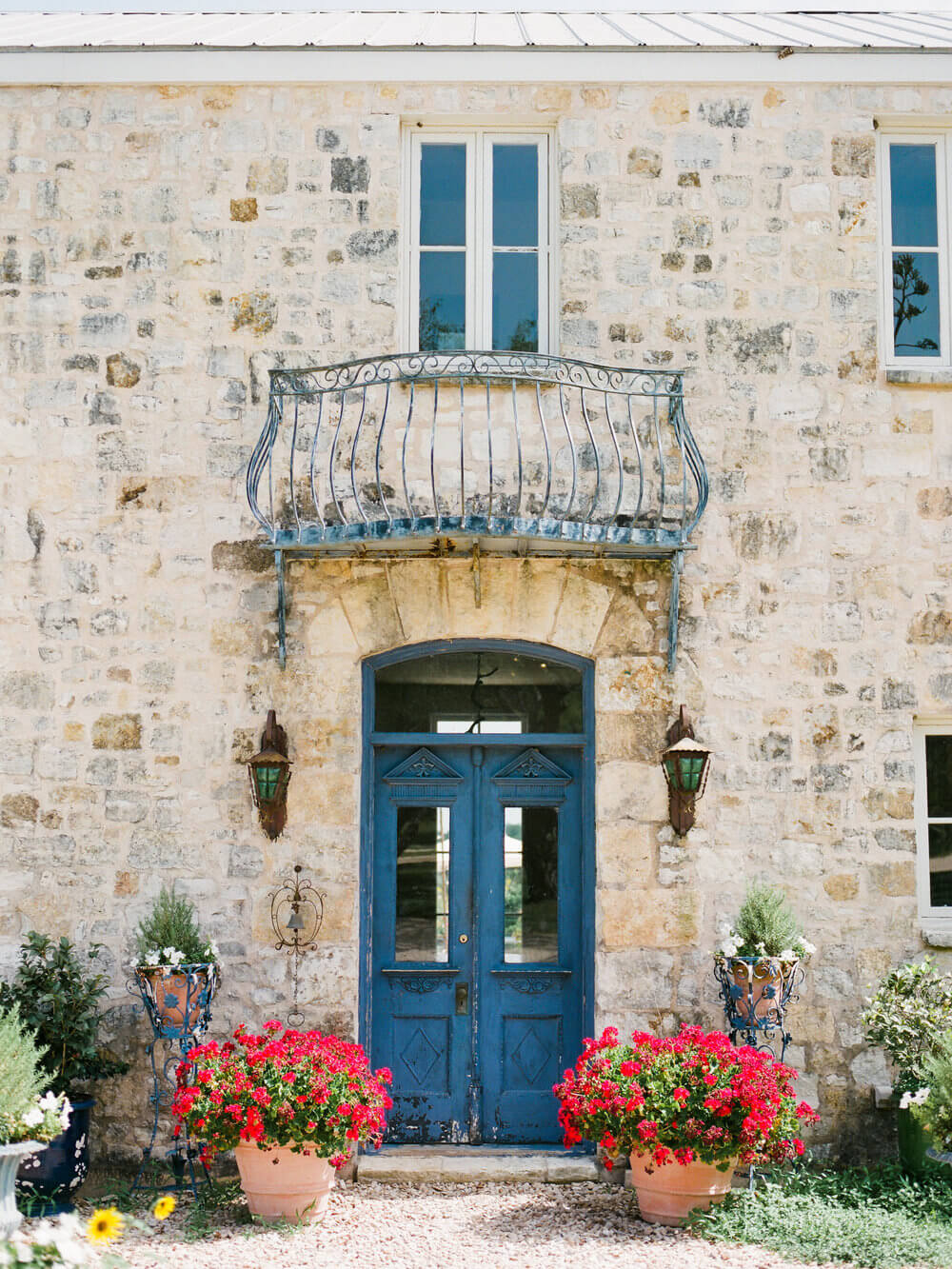 French country wedding inspiration venue location in Texas. Blue door and accents.
