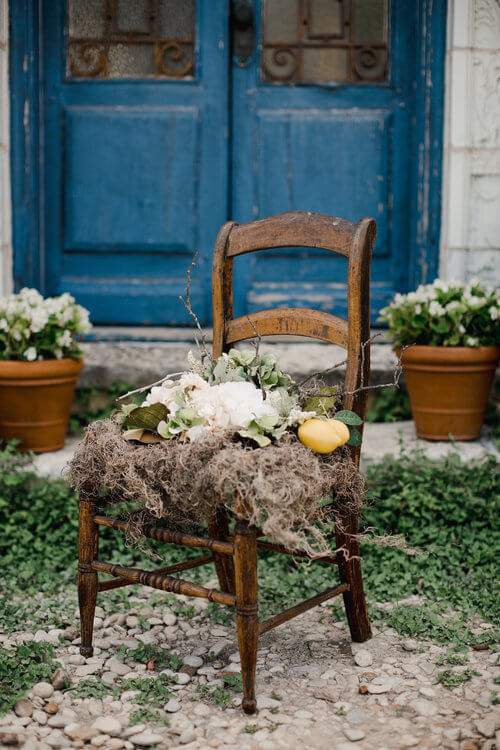 Vintage chair with French flair, decorated with floral, greenery, and lemons.