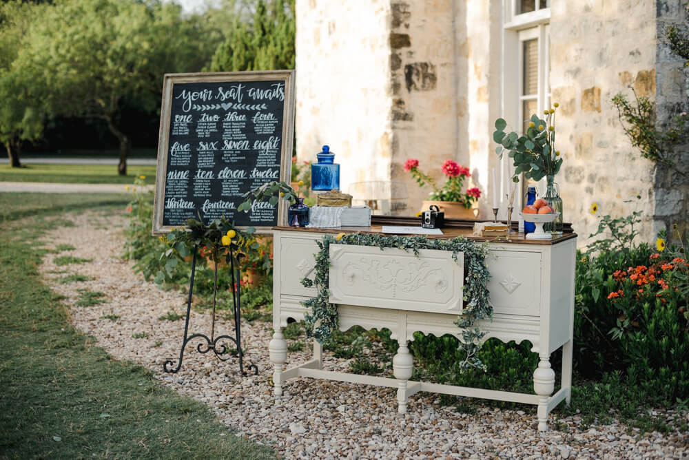 French country wedding inspiration furniture, guestbook, seating chart chalkboard.
