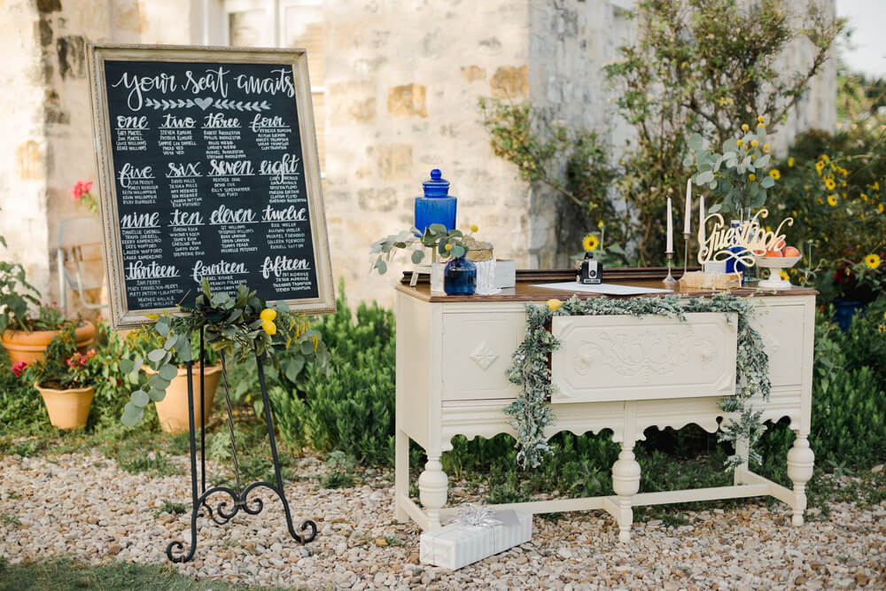 French country wedding inspiration seating chart, vintage furniture, guest book, entrance.
