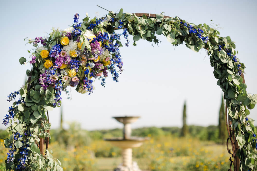 Floral and greenery wedding ceremony arch for French country wedding inspiration.