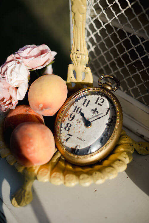 French antique decor with fresh peaches on an antique desk.