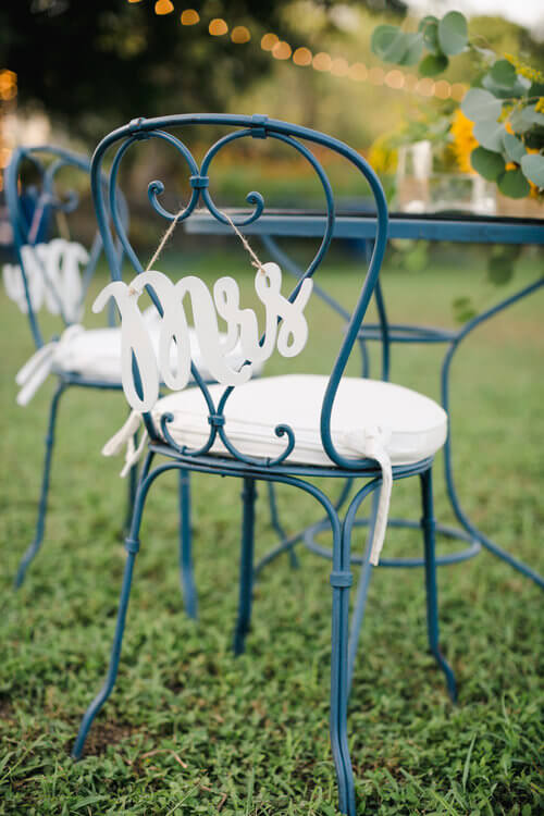 French country wedding inspiration with Mrs chair sign.