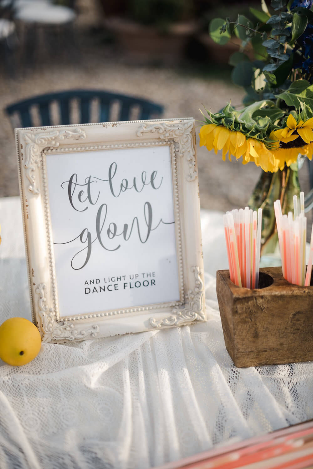 French country wedding inspiration table styled with glow sticks and props for the dance floor.