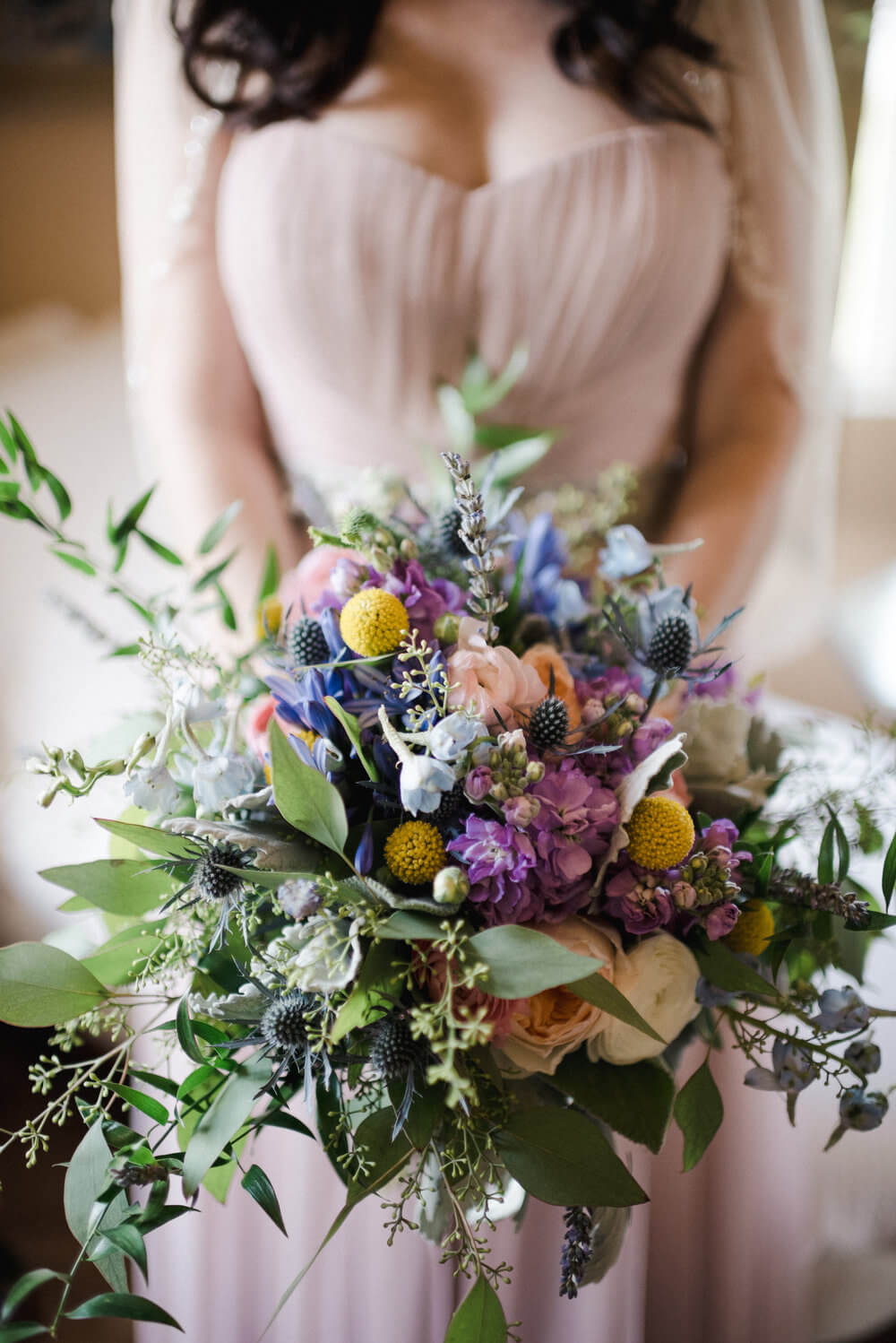 French country wedding inspiration floral bouquet with pink wedding dress.