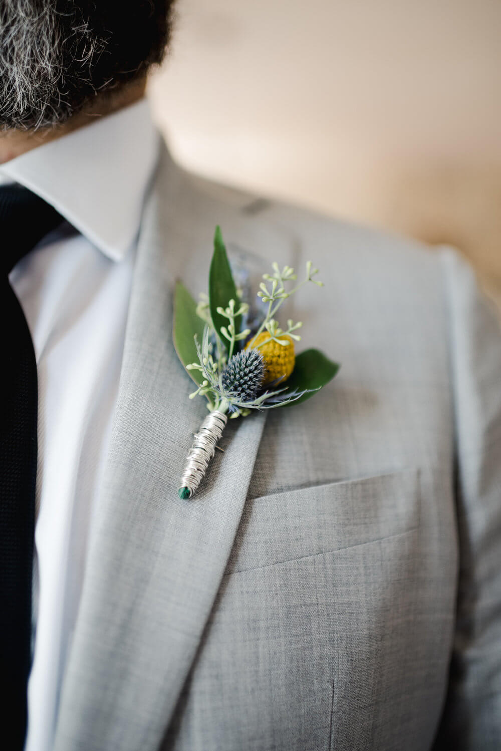 French country wedding inspiration gray grooms suit with boutonniere