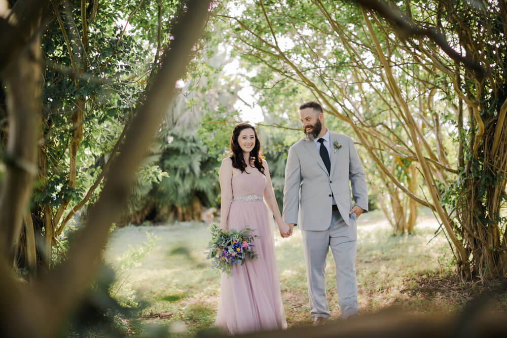 French Parisian wedding inspiration bride and groom, pink wedding dress.