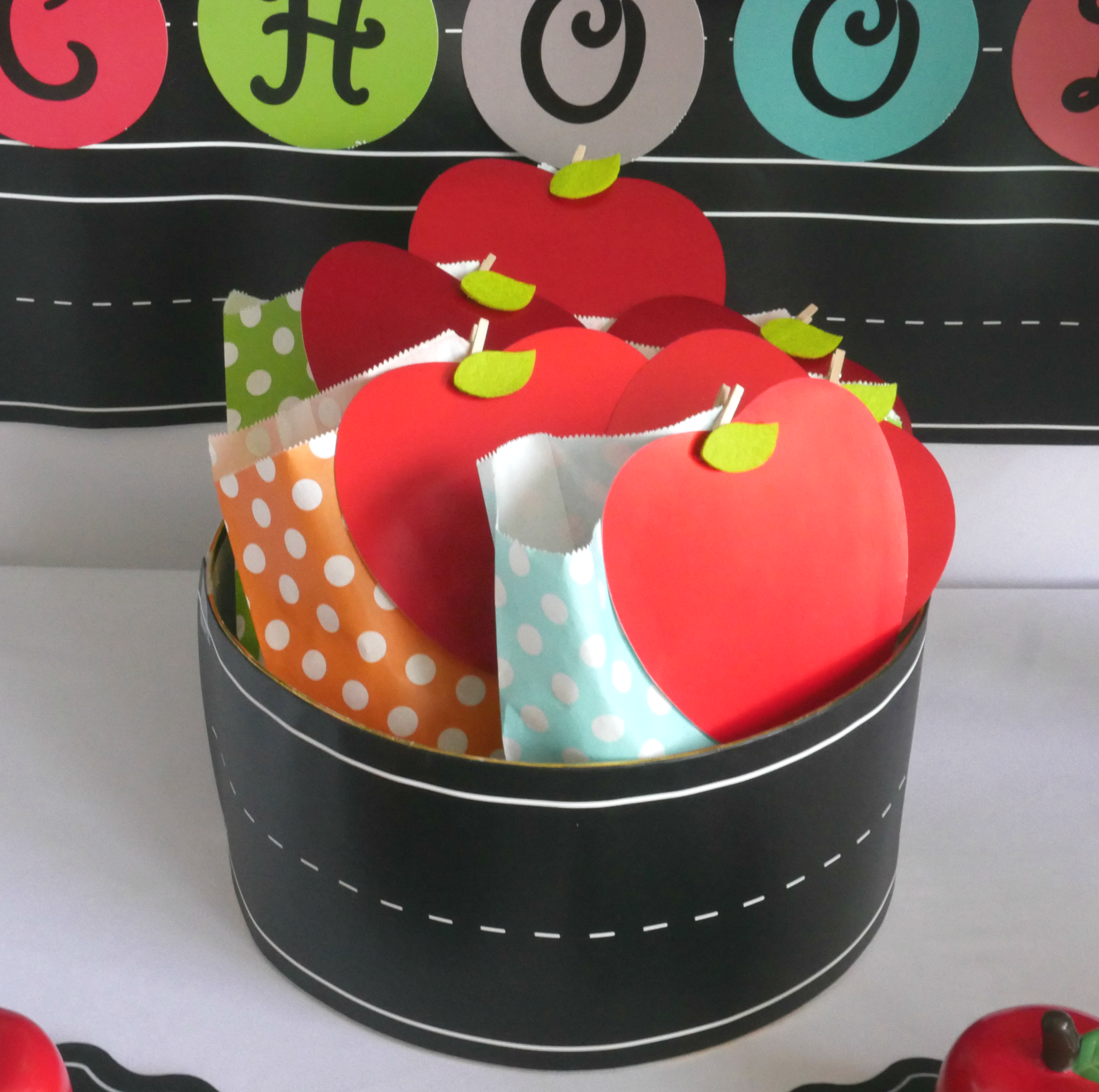 Cute Back to School party themed treat bags - simply use polka dot treat bags with cute apple bag toppers cut out of paper. See all the back to school party details on Mint Event Design www.minteventdesign.com #backtoschool #backtoschoolideas #kidsparty #kidspartyideas #kidsparties #partyfavors