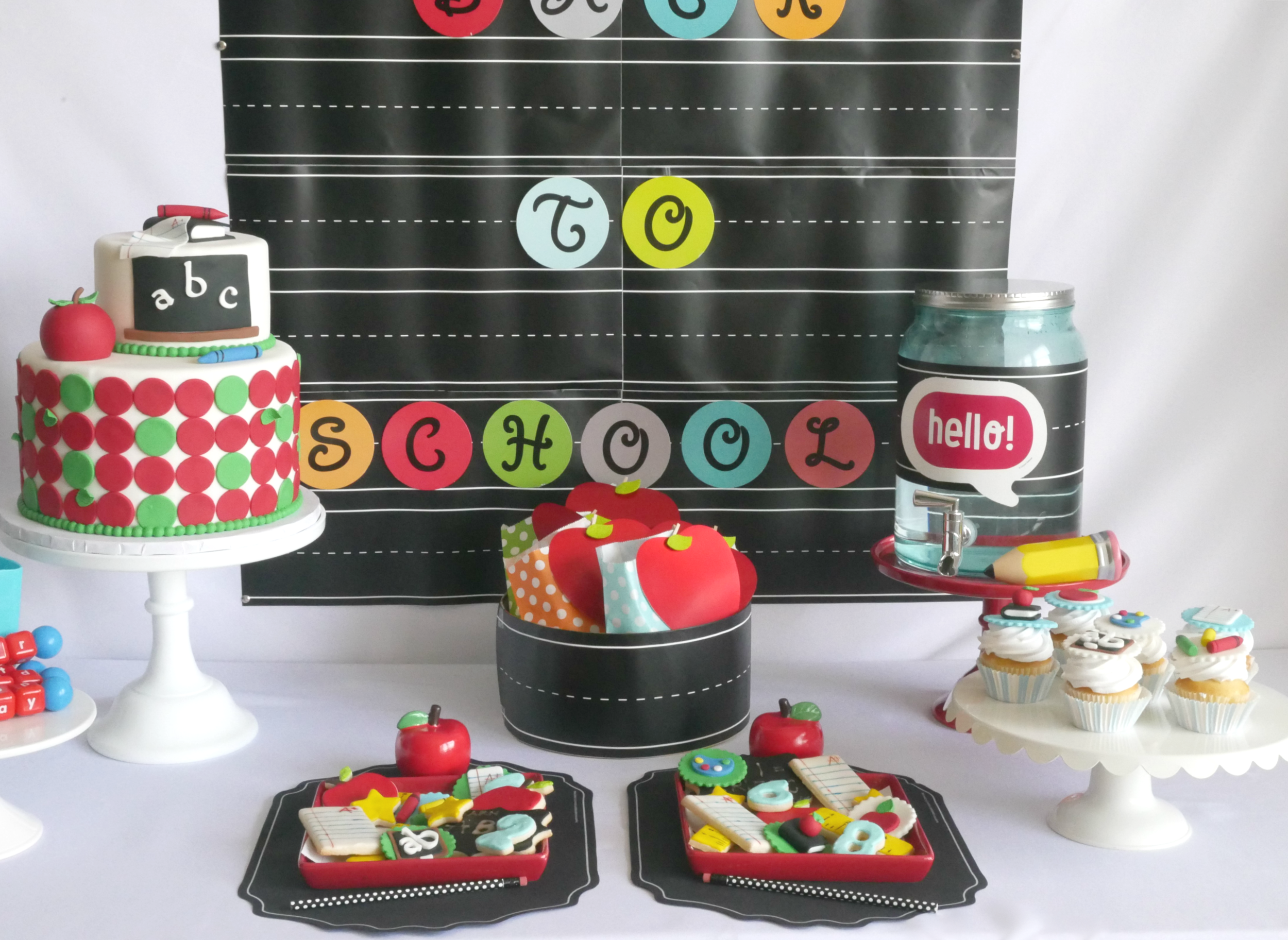 Bright and colorful dessert table at a back to school party. Love the chalkboard details, and all the adorable apple details. See all the back to school party details on Mint Event Design www.minteventdesign.com #backtoschool #backtoschoolideas #kidsparty #kidspartyideas #kidsparties #desserttable