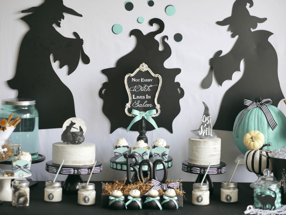 A modern and sophisticated Halloween Party in black, white and teal. The theme is based on Not All Witches Live in Salem and even features mini cauldrons. Click to see the entire Halloween party styled by party stylist Mint Event Design. #halloweenparty #partyideas #partyinspiration #desserttable #halloween #halloweencakes #halloweendesserts