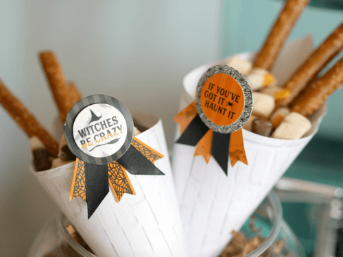 Witches Be Crazy! If you've got it, Haunt it! Love these fun food tags at this modern teenage Halloween Party. There's so many more Halloween party ideas from stylist Mint Event Design on the blog. #halloweenparty #partyideas #partyinspiration #halloween #halloweenideas #halloweendecorations #halloweensnacks