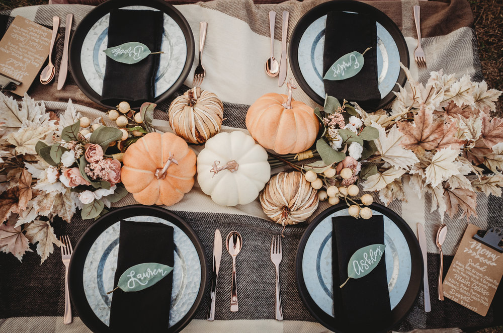 Pretty fall tablescape for a rustic themed bridal shower with chalkboard chargers and the menu was written on a clipboard. Click to see all the details of this fall bridal shower by party stylist Mint Event Design. #bridalshowers #bridalshowerideas #rusticwedding #rusticbridalshower #bridalshowerdecor #farmwedding #tablesetting #centerpiece #pumpkins #pumpkindecor #placecards