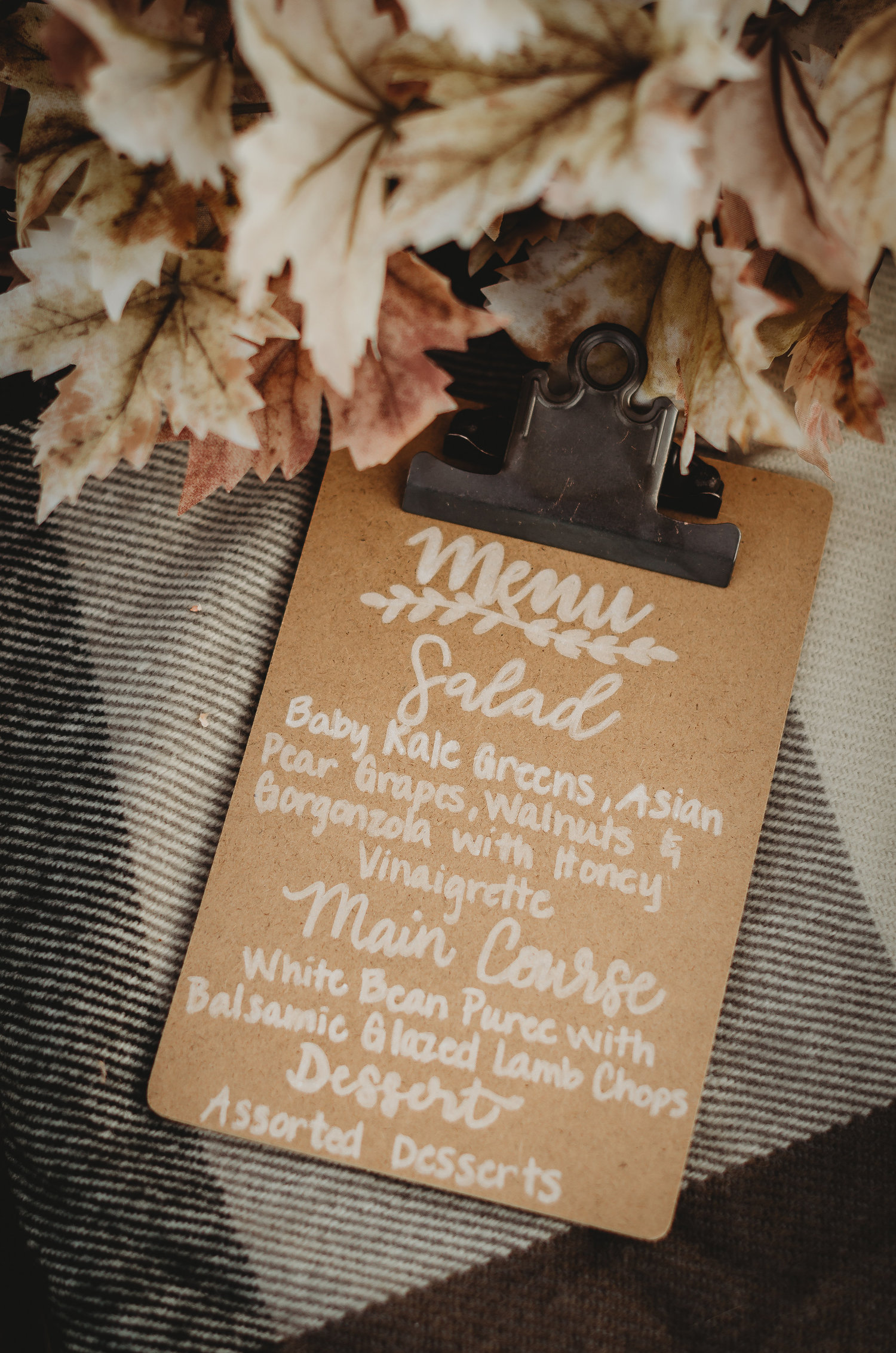 Bridal Shower Menu DIY - instead of attaching paper to mini clipboards - you can write directly on the clipboard with a white calligraphy pen. Click to see even more details of this fall bridal shower by party stylist Mint Event Design. #bridalshowers #bridalshowerideas #rusticwedding #rusticbridalshower #bridalshowerdecor #farmwedding #menu #calligraphy #bridalshowerdiy