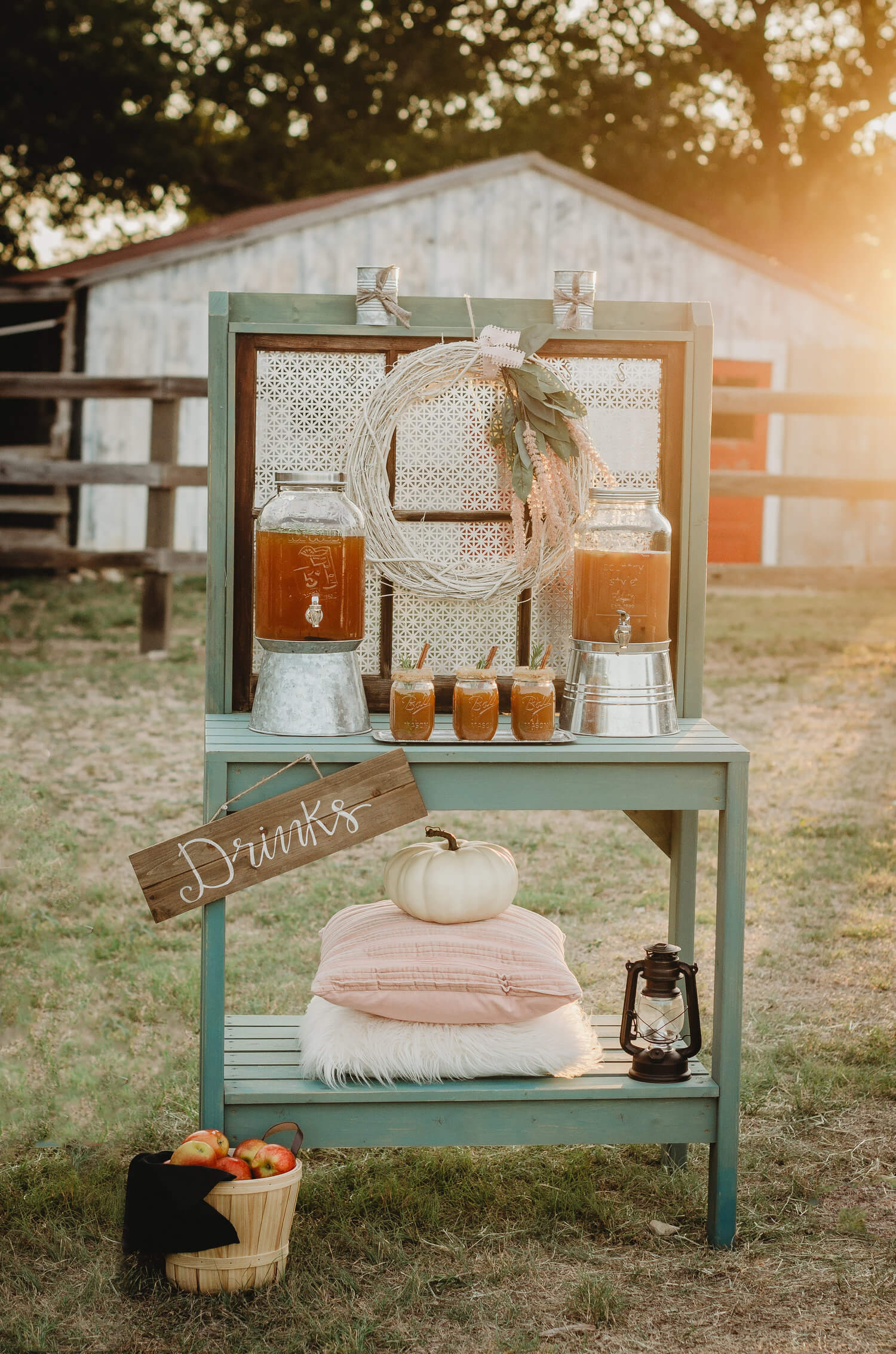 This rustic Bridal Shower Drink Station is created with a gardeners tool table. Caramel apple cider and an apple pie cocktail are the perfect drinks for your drink bar for fall parties. Click to see even more details of this fall bridal shower by party stylist Mint Event Design. #bridalshowers #bridalshowerideas #rusticwedding #rusticbridalshower #bridalshowerdecor #farmwedding #drinkstation #drinkbar