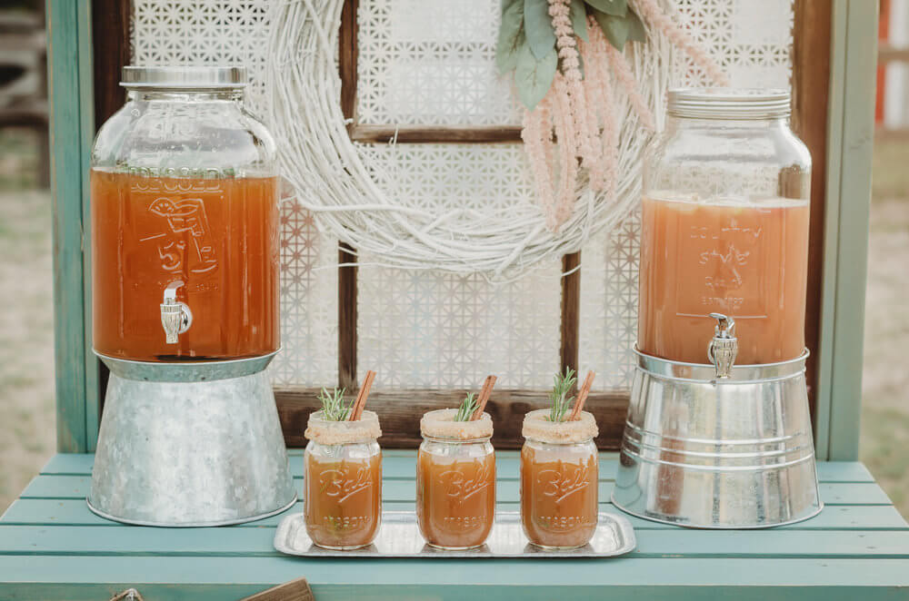 Details from a rustic bridal shower drink station. Click to see even more details of this fall bridal shower by party stylist Mint Event Design. #bridalshowers #bridalshowerideas #rusticwedding #rusticbridalshower #bridalshowerdecor #farmwedding #drinkstation #drinkbar