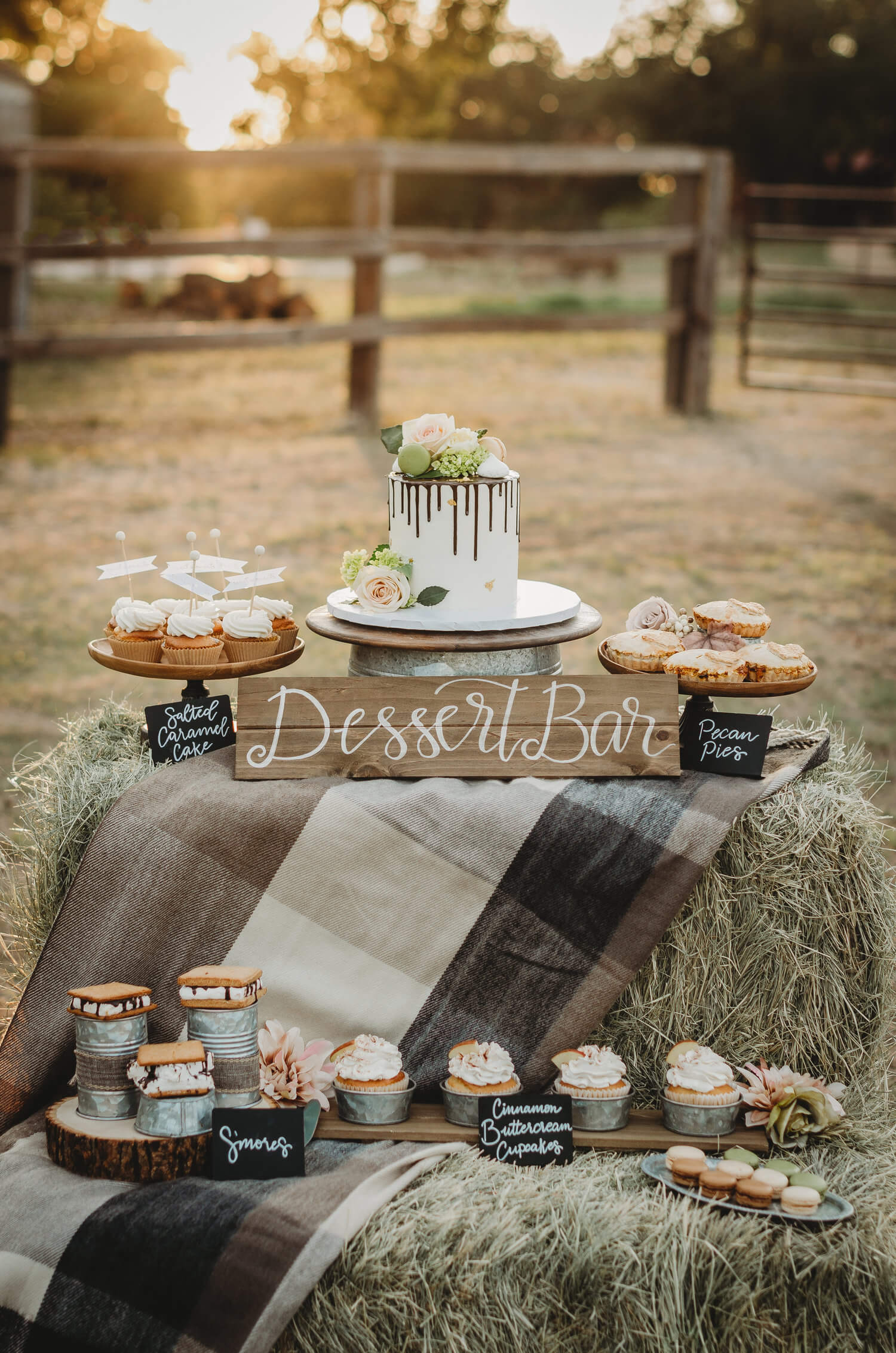 This drip frosted cake takes the spotlight at this Rustic Bridal Shower. Click to see many more bridal shower ideas from this Fall in Love party theme. Created by party stylist Mint Event Design. #bridalshowers #bridalshowerideas #rusticwedding #rusticbridalshower #bridalshowerdecor #farmwedding #partyideas #fallbridalshower #dessertbar