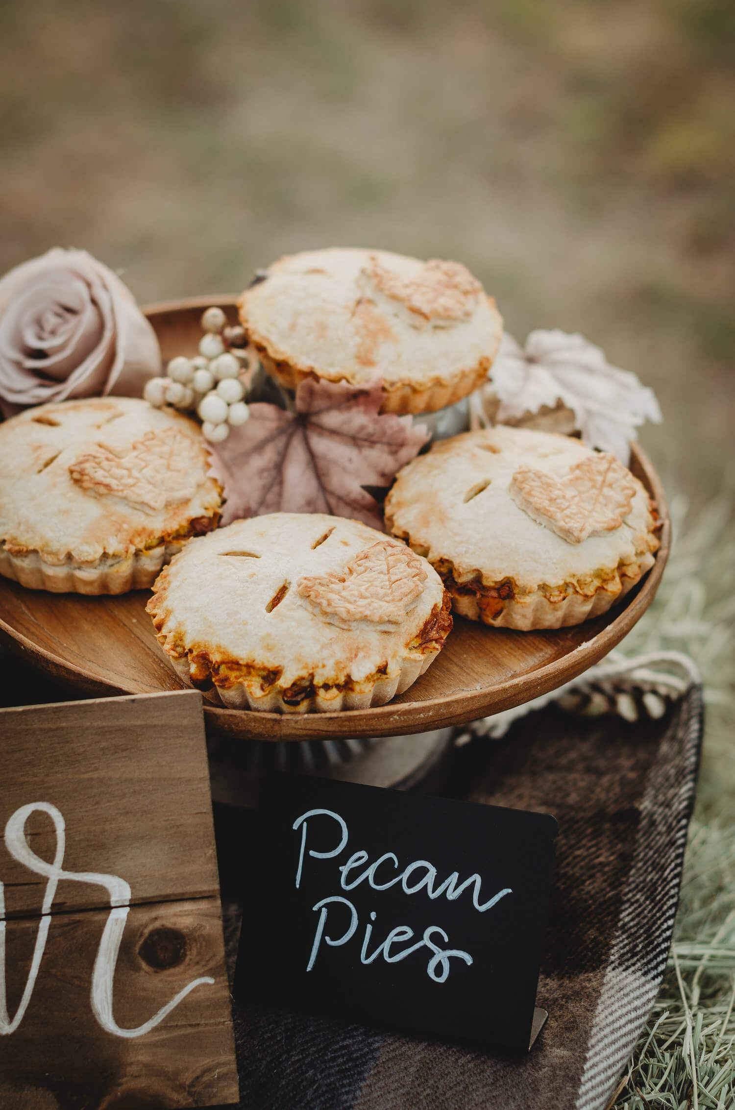 Yummy mini pecan pies are the perfect dessert for this fall themed bridal shower on a farm. Click to see many more bridal shower ideas from this Fall in Love party theme. Created by party stylist Mint Event Design. #bridalshowers #bridalshowerideas #rusticwedding #rusticbridalshower #bridalshowerdecor #farmwedding #partyideas #fallbridalshower #pecanpies #bridaslshowerdessert #minidesserts