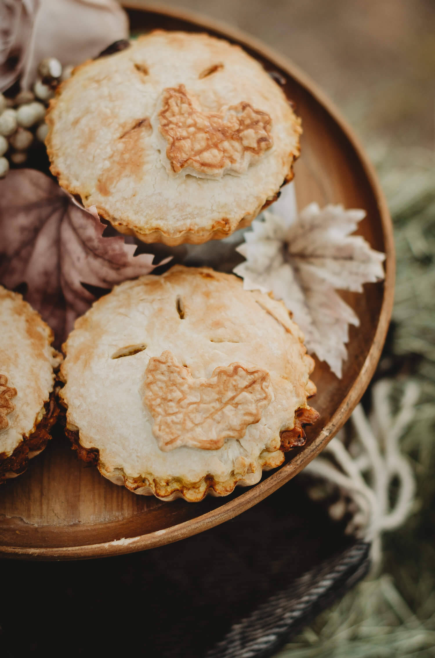 Yummy mini pecan pies that are topped with leaf cutouts. The perfect dessert for a falling in love themed bridal shower. Click to see many more bridal shower ideas from this Fall in Love party theme. Created by party stylist Mint Event Design. #bridalshowers #bridalshowerideas #rusticwedding #rusticbridalshower #bridalshowerdecor #farmwedding #partyideas #fallbridalshower #pecanpies #bridaslshowerdessert #minidesserts