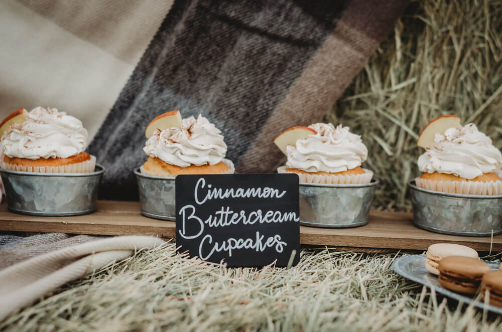 The perfect rustic party dessert bar decor: Write your dessert choices on chalkboard signs Click to see many more bridal shower ideas from this Fall in Love party theme. Created by party stylist Mint Event Design. #bridalshowers #bridalshowerideas #rusticwedding #rusticbridalshower #bridalshowerdecor #farmwedding #partyideas #fallbridalshower #cupcakes #bridaslshowerdessert #minidesserts
