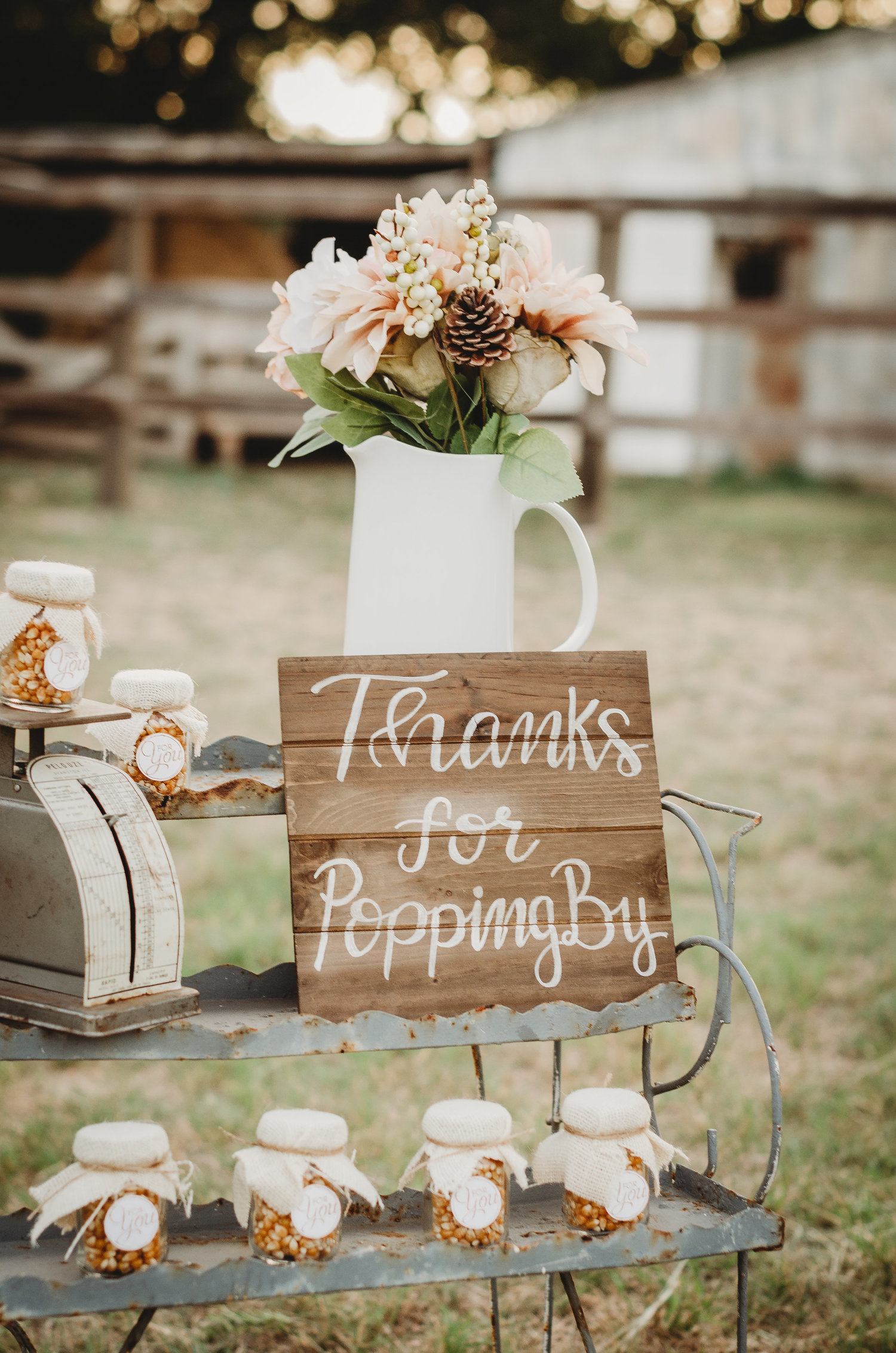 "Giving our popcorn as your party favor? Easily create a wooden sign that reads ""Thanks for Popping by"" as the party decor. Click to see even more rustic party ideas from this fall themed bridal shower. Created by party stylist Mint Event Design. #bridalshowers #bridalshowerideas #rusticwedding #rusticbridalshower #bridalshowerdecor #farmwedding #partyideas #fallbridalshower #woodensign"