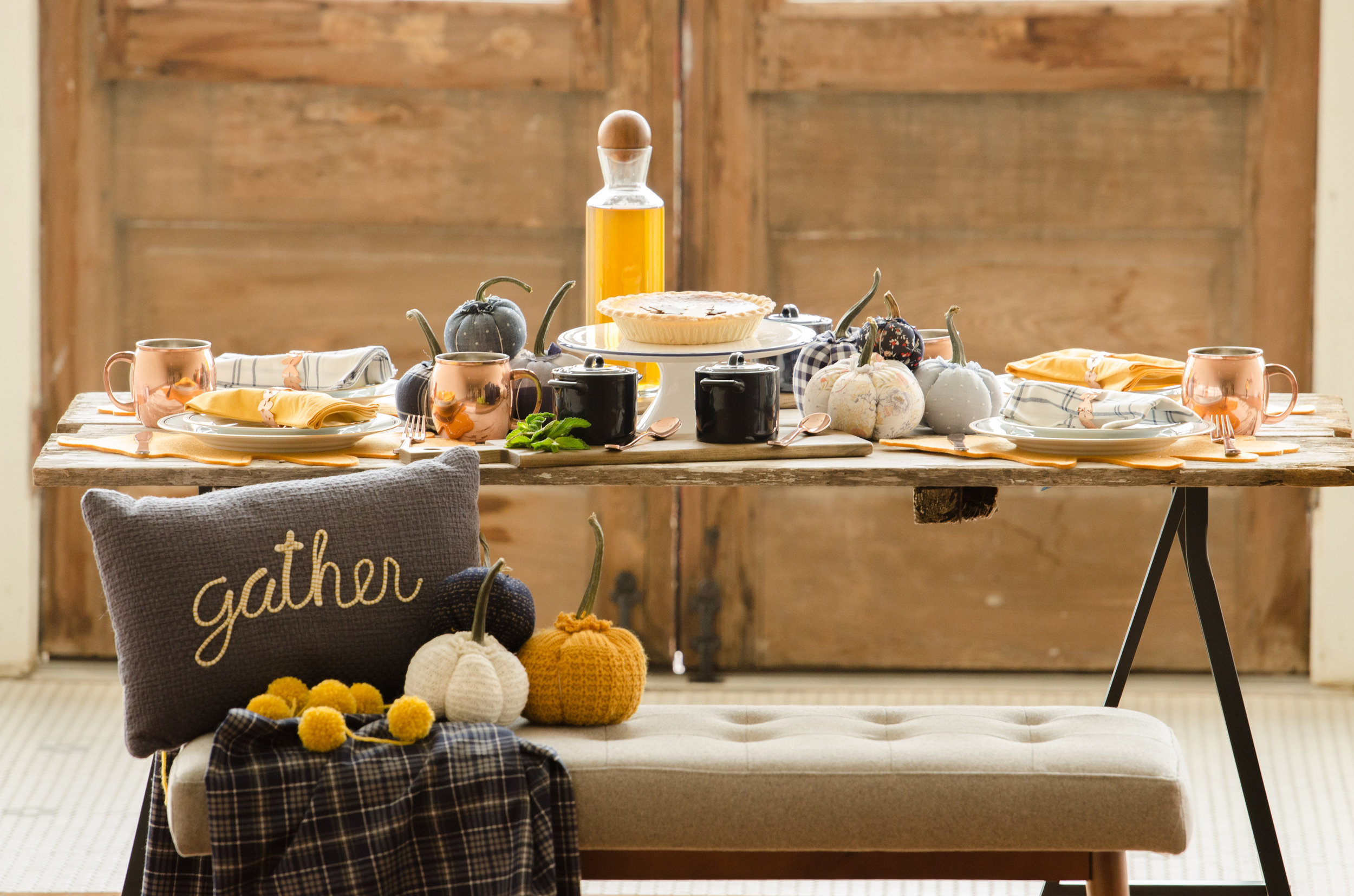 Gather around for Cozy and Stylish Thanksgiving table setting ideas in the color palette of cream, orange and blue with copper elements. See more Thanksgiving Pictures from party planner, Mint Event Design in Austin, Texas on www.minteventdesign.com #thanksgiving #thanksgivingdecorations #tablescape #thanksgivingtable #pumpkins