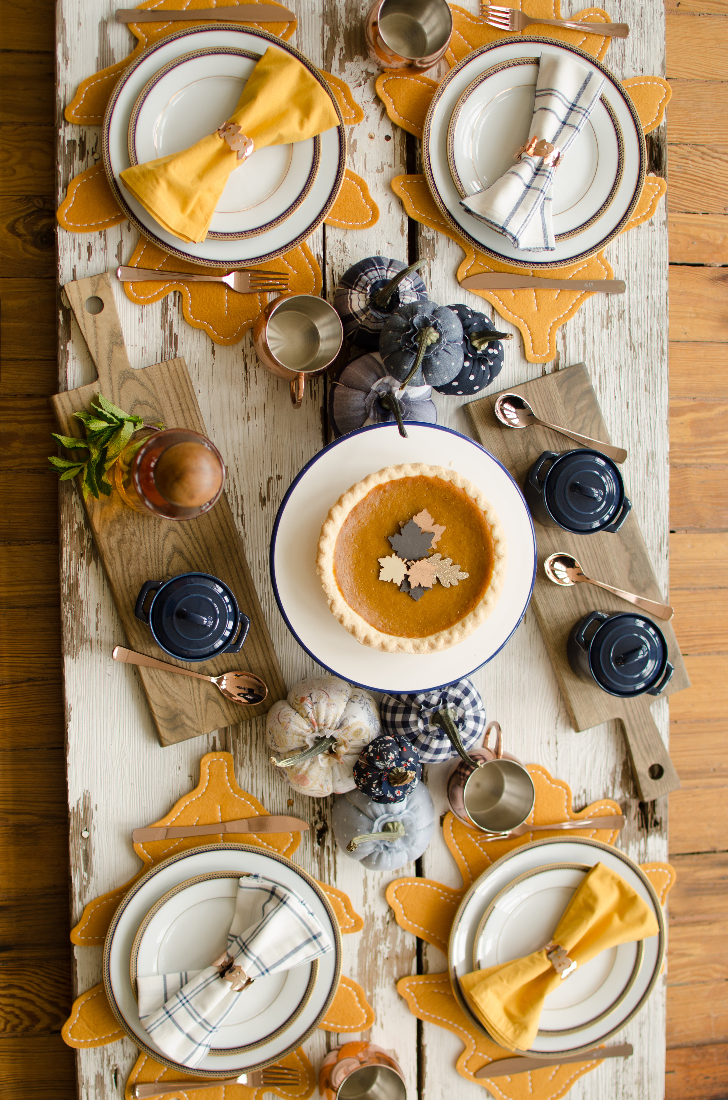 This Thanksgiving Table with Copper and Blue tones throughout creates the perfectly cozy and rustic table setting for your party gatherings. See more Thanksgiving Party Ideas from party planner, Mint Event Design in Austin, Texas on www.minteventdesign.com #thanksgiving #thanksgivingdecorations #tablescape #thanksgivingtable #pumpkins #tablesettings #fallparty