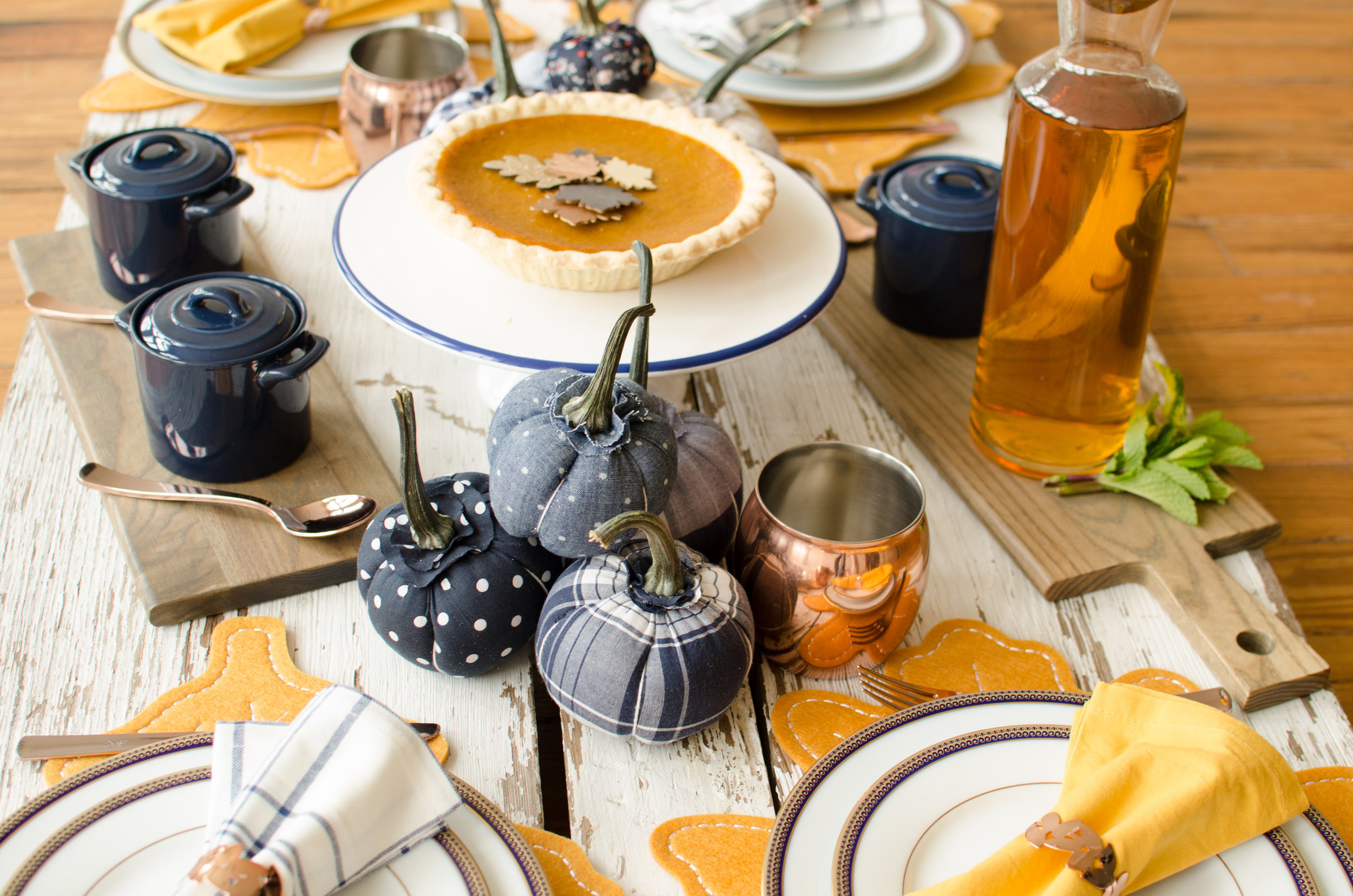 Fabric pumpkins in fun patterns will add a bit of fun to your beautiful Thanksgiving table. See more Thanksgiving Party Ideas from party planner, Mint Event Design in Austin, Texas on www.minteventdesign.com #thanksgiving #thanksgivingdecorations #tablescape #thanksgivingtable #pumpkins #tablesettings #fallparty