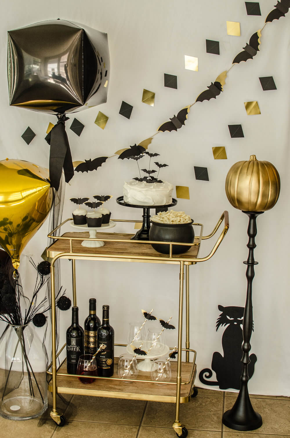 Adding a few elegant touches can really elevate a simple bar cart and make your Halloween bash so classy. Styled by party stylist Carolina of Mint Event Design. #partyideas #partyinspiration #halloween #barcart #barcartdecor