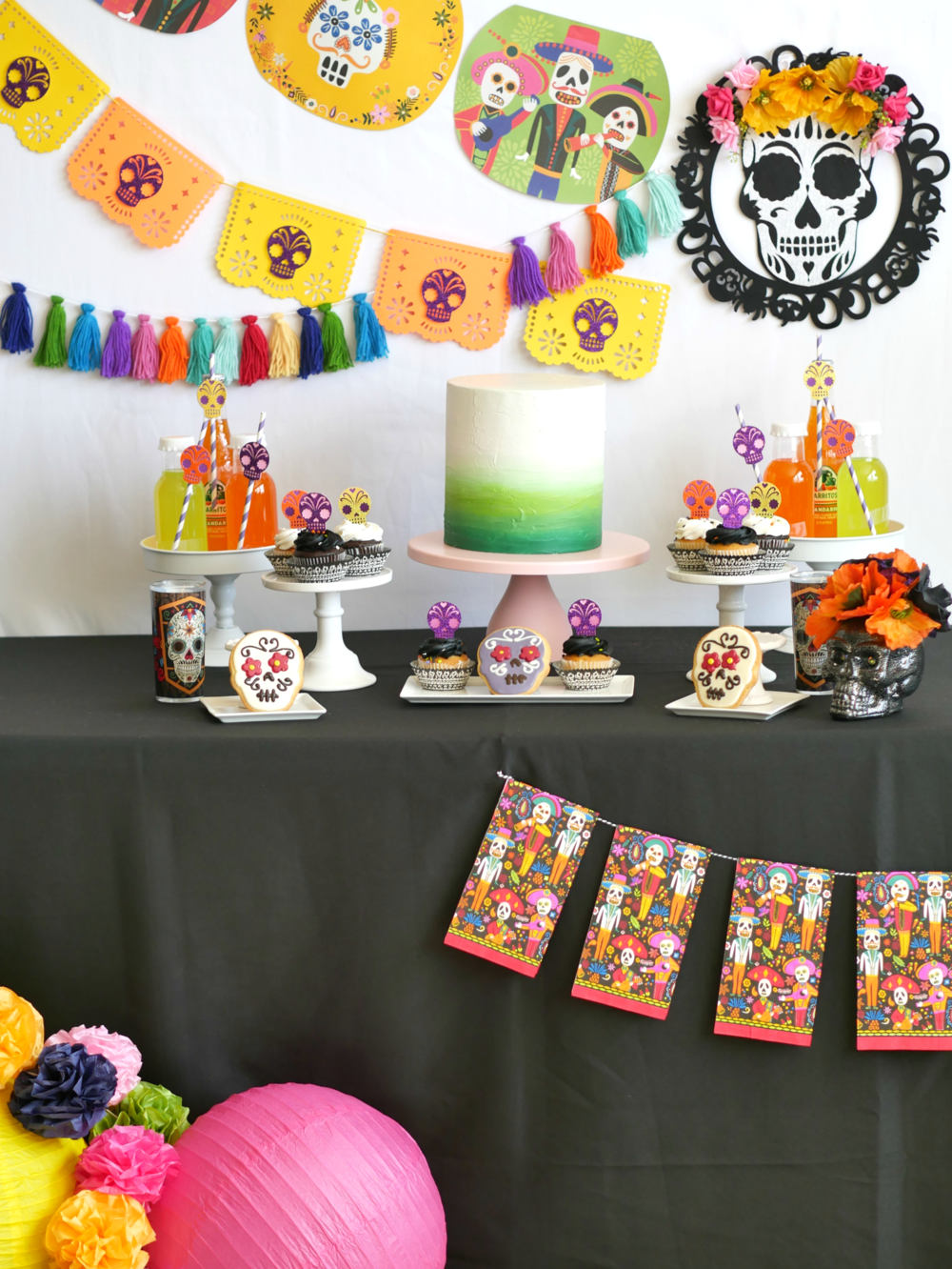 Find how to create these colorful Papel Picado banners from Day of the Dead themed napkins and paper lanterns on the Mint Event Design party blog from the Austin, Texas based party stylist www.minteventdesign.com #dayofthedead #diadelosmuertos #sugarskulls #mexicanparty #partyideas #papelpicado #partydecor