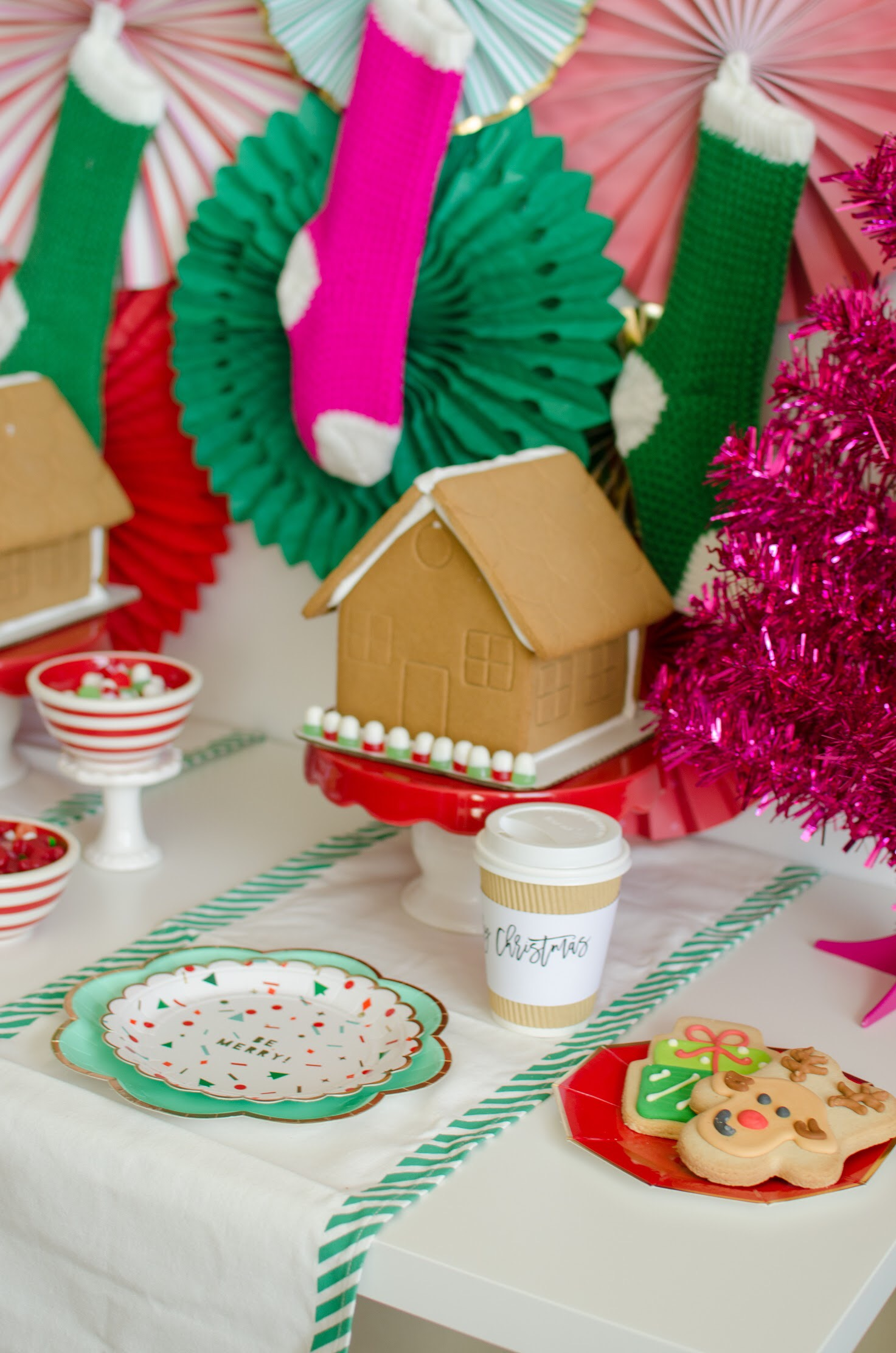 These beautifully decorated sugar cookies are the perfect addition to this gingerbread party. See the full decorating details and party set up design on Mint Event Design www.minteventdesign.com #gingerbreadhouse #holidayparty #holidays #partyideas #christmasparty #holidaypartyideas #kidsparty #christmascookies