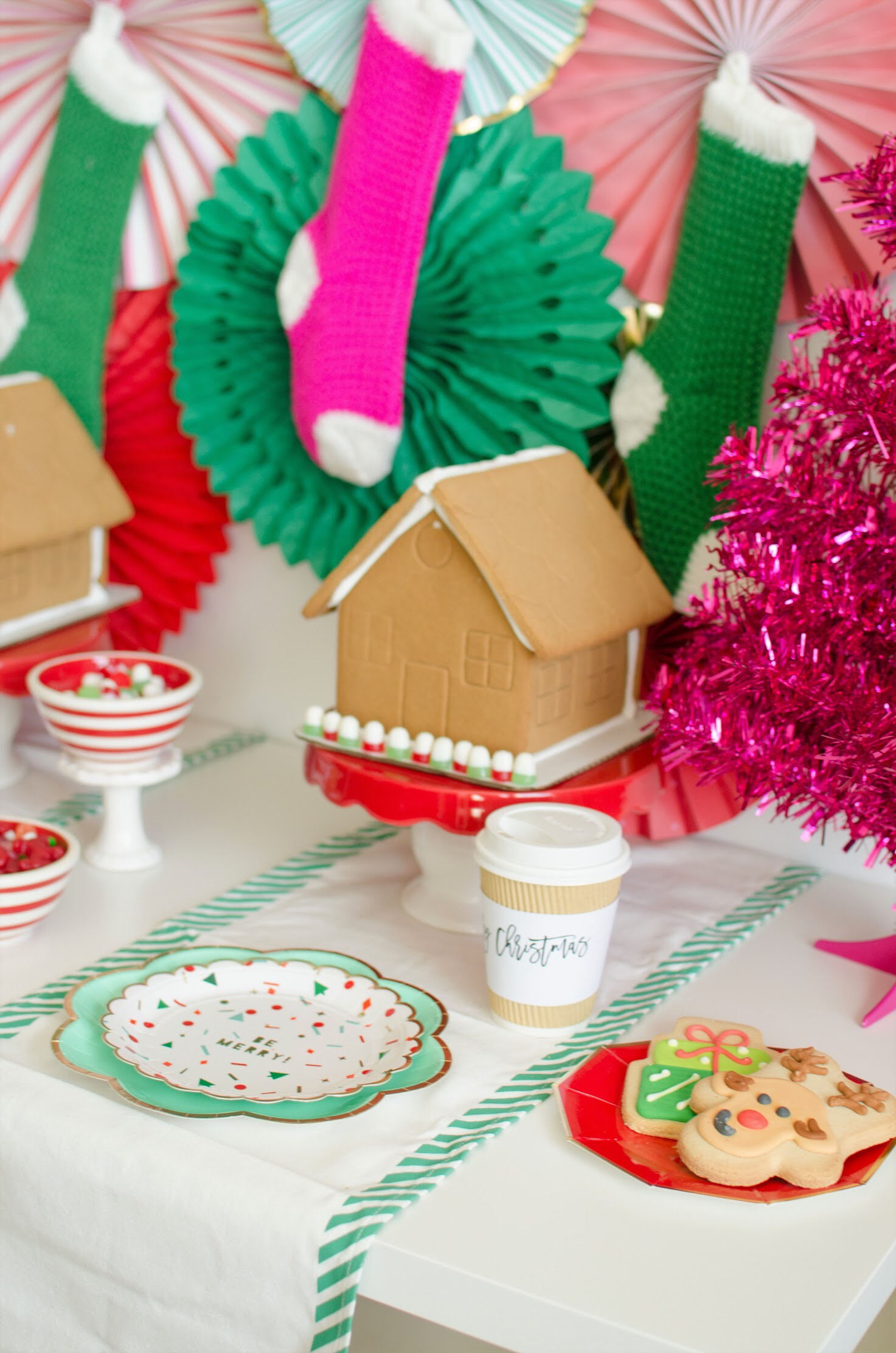 Sugar cookies and hot cocoa are on the menu at this gingerbread house decorating party. See the full decorating details and party set up design on Mint Event Design www.minteventdesign.com #gingerbreadhouse #holidayparty #holidays #partyideas #christmasparty #holidaypartyideas #kidsparty