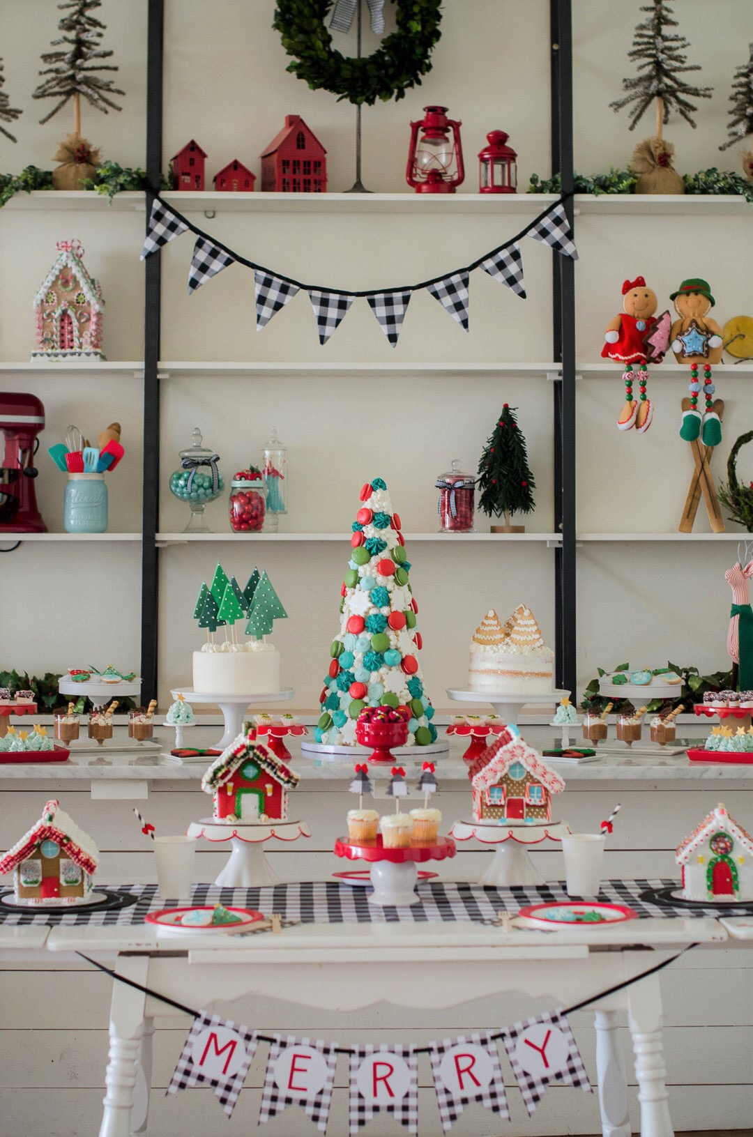 Beautifully decorated gingerbread houses and desserts at this lovely Christmas party. See more holiday party inspiration from Austin based party stylist Mint Event Design at www.minteventdesign.com #desserttable #christmasdesserts #holidayparty #holidays #partyideas #christmasparty #holidaypartyideas