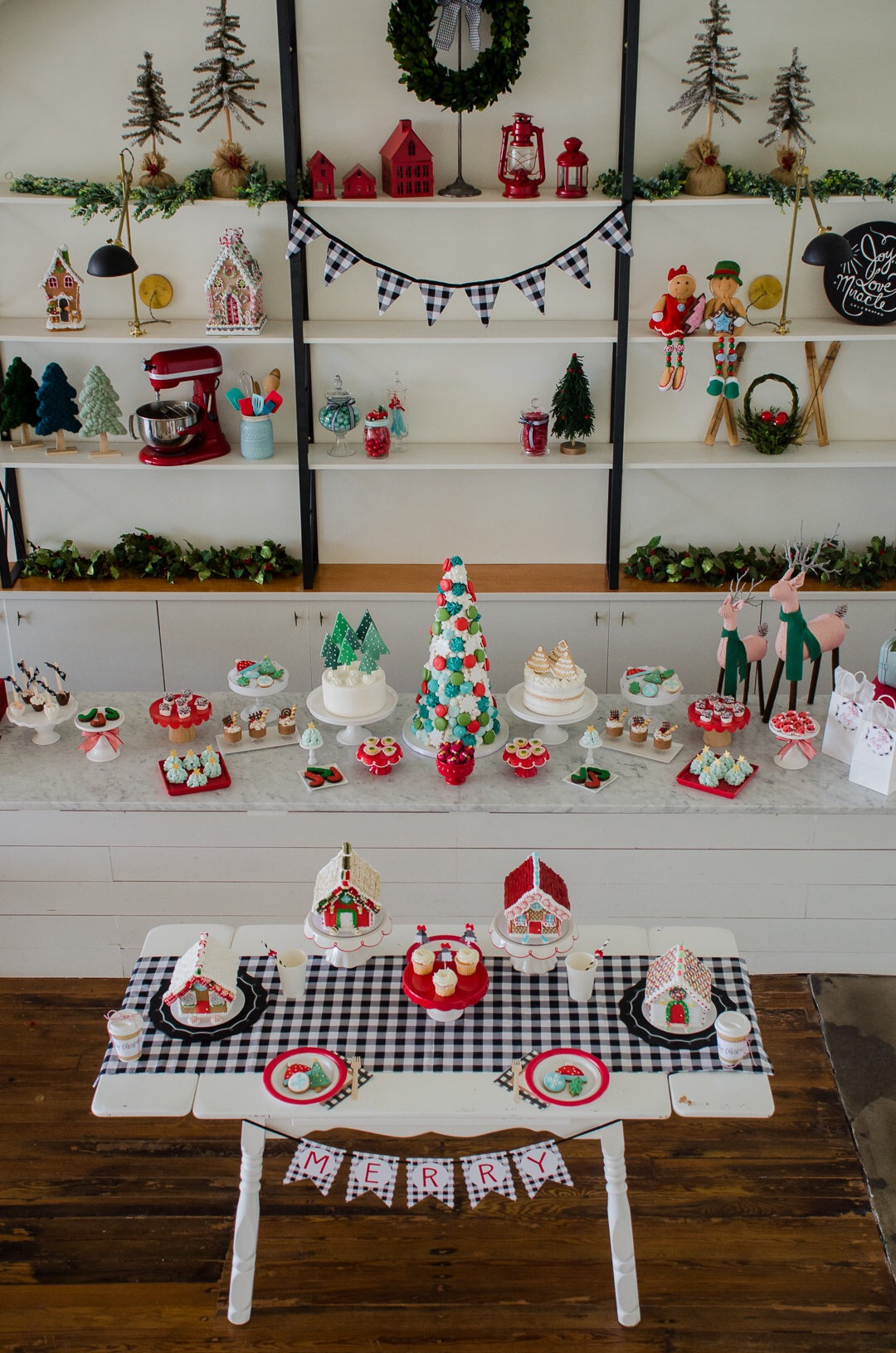 Buffalo Check and Red themed Holiday party decorations. Love the farmhouse retro look of this Christmas party. See more holiday party inspiration from Austin based party stylist Mint Event Design at www.minteventdesign.com #desserttable #christmasdesserts #holidayparty #holidays #partyideas #christmasparty #holidaypartyideas